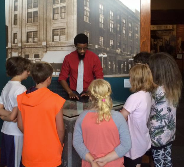 An MTCC tour director teaches Little Rock area students about the history of the MTCC pediment.  Help us pass down the story of the Mosaic Templars to younger generations and teach them about the contributions African Americans made to Arkansas culture by making a donation today.