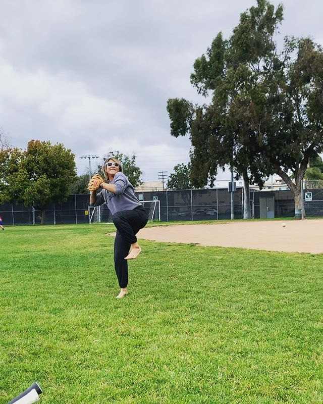 "SWIPE LEFT 👈🏼👈🏼 . • ""Laughter is the best medicine."" 😂 . • I wanted to play team sports growing up but never felt comfortable enough because the pressure to win and not let my team down was too much for me to handle at the time.  On this day, Venus and Lia invited me to play catch.  I think I've held a mitt 3x total in my life.  The thought of playing never occurred to me.  At the beginning, I was a little frightened.  The ball was coming at me and instead of wanting to catch it, I wanted to duck. 😂 I would have given up after the first few tries but Venus wouldn't let me.  She pulled me to the side and threw the ball while coaching me to keep my focus on the ball.  After a few tries, I finally caught it.  She threw it again.  I caught it.  And again. I caught it.  The connection gave me the confidence to push past my fear of failing and I finally caught it! I even threw it back to Lia without under or overthrowing. I was proud of myself and I believe it's what we as humans want to feel truly at the heart.  Whatever brings us back to the truth.  Practice.  Make mistakes.  Learn.  Own it.  Be responsible.  Fearless to let ourselves be seen.  Take five steps ahead.  Take three steps back. Process with compassion to self so you can be seen and see.  The truth.  The tribe.  Your vibe.  The spirit.  The human.  The being. 💚✨🙏🏼 . • Thank you to my sisters @venus2bfab and @liab222 for what you did for me that day. 🥰 . • If you like my ""Yoga Stoned"" sweatshirt, my girl Alex aka @namasteasfuck can help you! 🙌🏼 . • #flashbackfriday #friday #feelings #catch #throw #be #spirit #practice #livelovelearn #play #innerchild #believe #support #grow #gratitude #resilience #energy #graceovergossip"