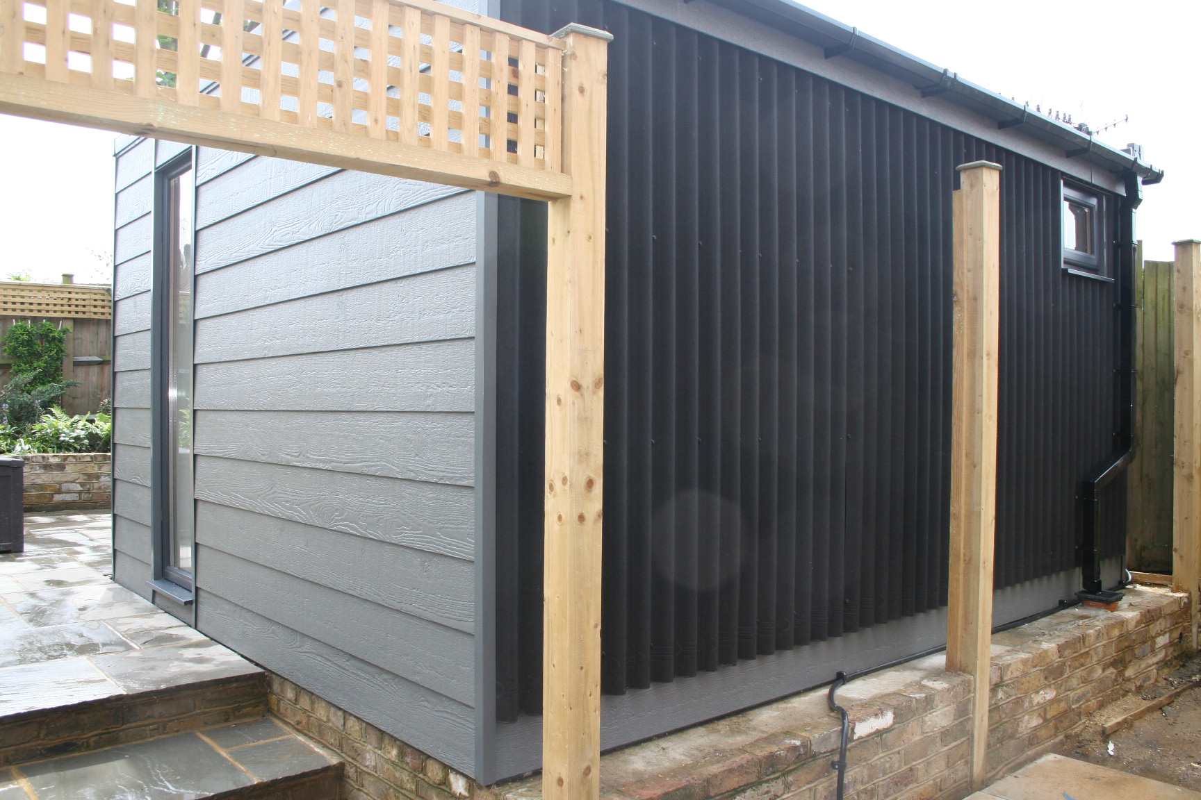 Rear Aspect Weather Board Option - For a large percentage of garden room installs the rear of the building will not be visible in day to day use. This is why we have the option to either clad the whole structure in the cladding of your choice or to use a weatherproof boarding to the rear, reducing the overall install price.