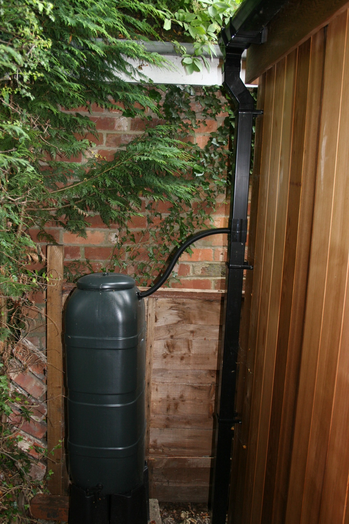 Rainwater Management - As standard:We install a full-length rear drip trim to all of our garden rooms. This distributes the roof surface rainwater across the full length of the rear of your garden room and clear of your rear cladding. This is an effective method for managing rainwater fall in most circumstance.As an option:We can install a full-length rear gutter profile, downpipe and a water butt to collect the roof surface rainwater runoff. A water butt is always required with a gutter and downpipe to prevent concentrated water flow onto the ground unless there is a drain present.