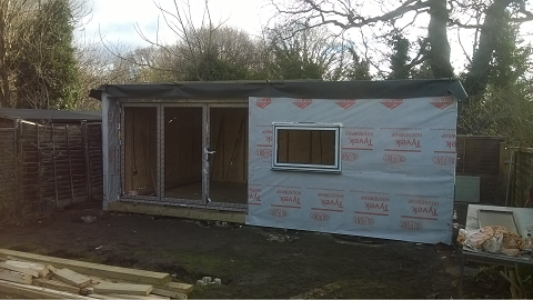 Day 5 - The exterior is wrapped and the windows and doors are fitted -