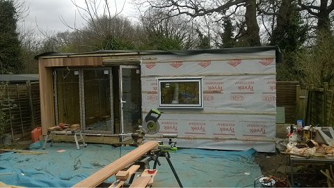 Day 6 - The exterior battens are fitted and the cladding process starts -