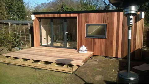 Day 11 - Cedar decking boards start to go down with matching deck edges -