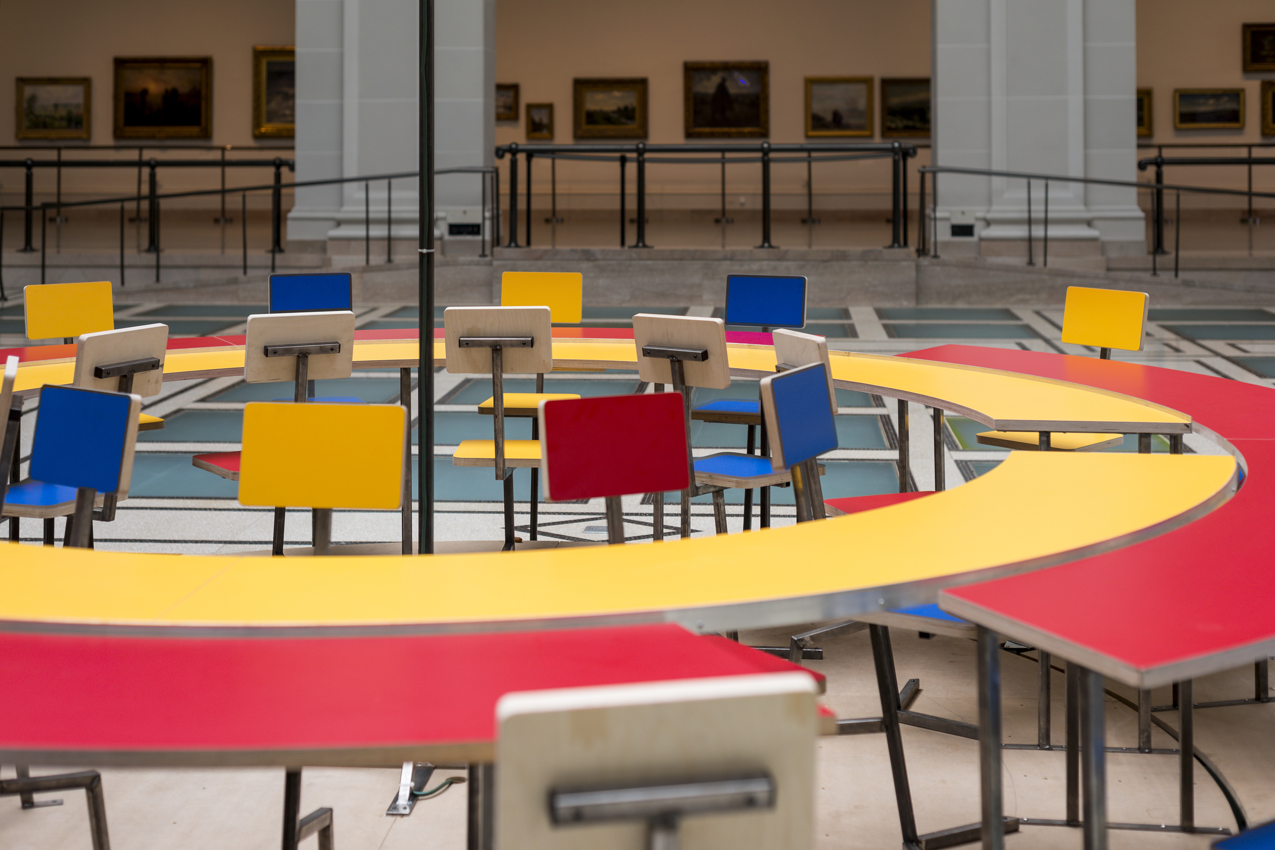 Detail of  Until the Cows Come Home  (2014), as installed at the Brooklyn Museum in 2014. Steel, neon, laminated mdf, pine; 60 x 168 in. (table), 24 x 60 in. (neon centerpiece). ( photo : Giles Ashford)