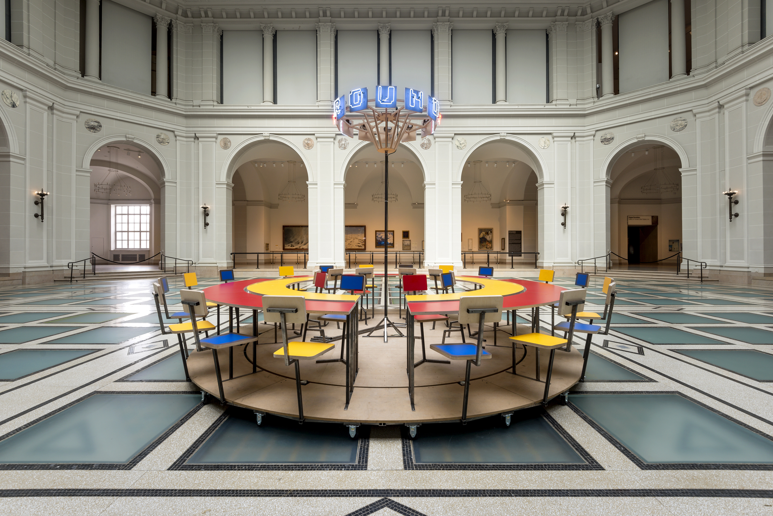 Until the Cows Come Home  (2014), as installed at the Brooklyn Museum in 2014. Steel, neon, laminated mdf, pine; 60 x 168 in. (table), 24 x 60 in. (neon centerpiece). ( photo : Giles Ashford)