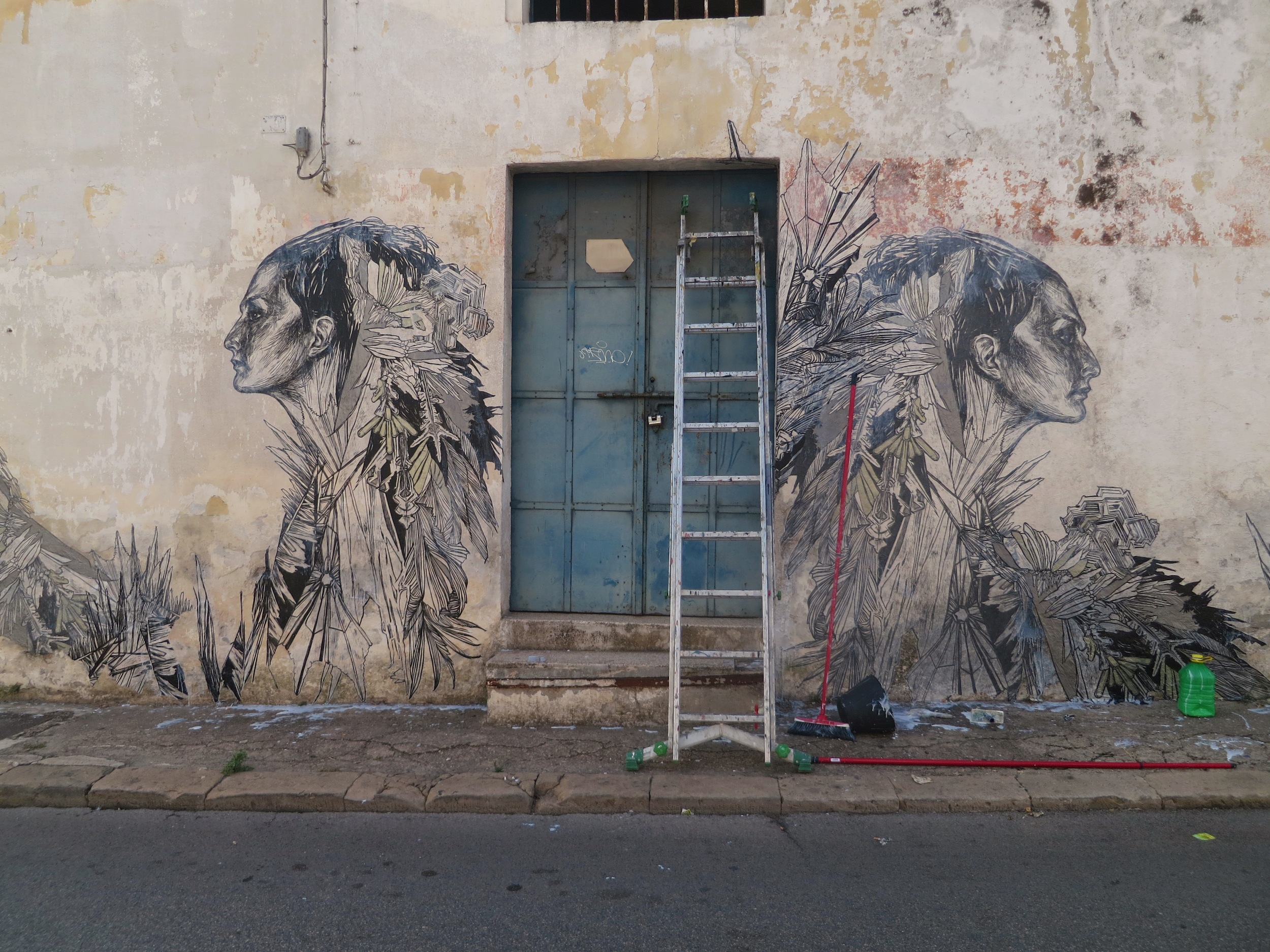 A 2013 street paste in Grottaglie, Italy. ( Photo : Swoon Studio)