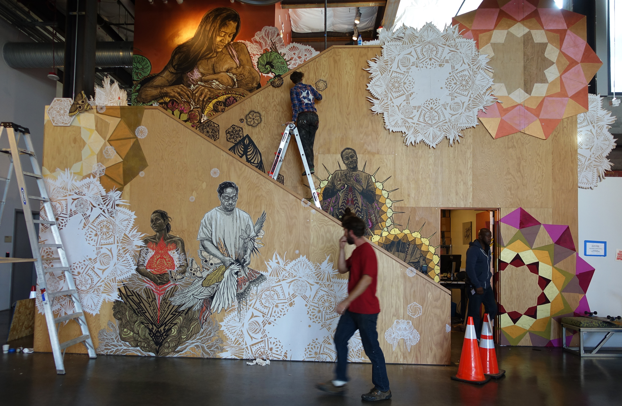 Swoon and her team install a site-specific work at Facebook Headquarters in Palo Alto, California. ( Photo : Swoon Studio)