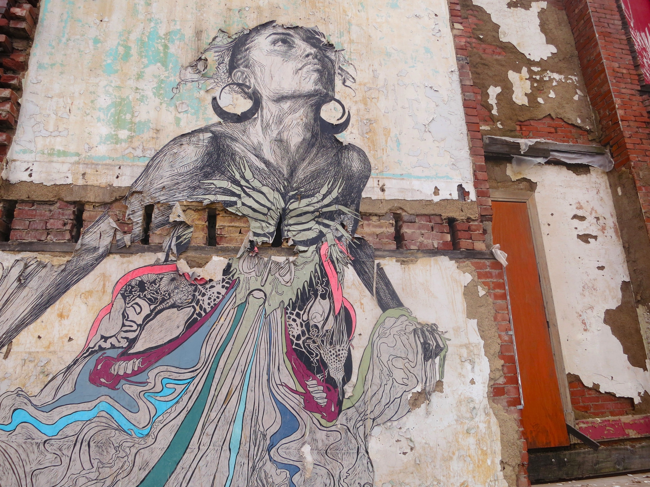 An example of the portraiture motifs Swoon employs across her work, the sea goddess Thalassa was the subject of a site-specific installation at the New Orleans Museum of Art as well as a two-story paste on the exterior of an abandoned church in Braddock, Pennsylvania. ( Photo : Tod Seelie)