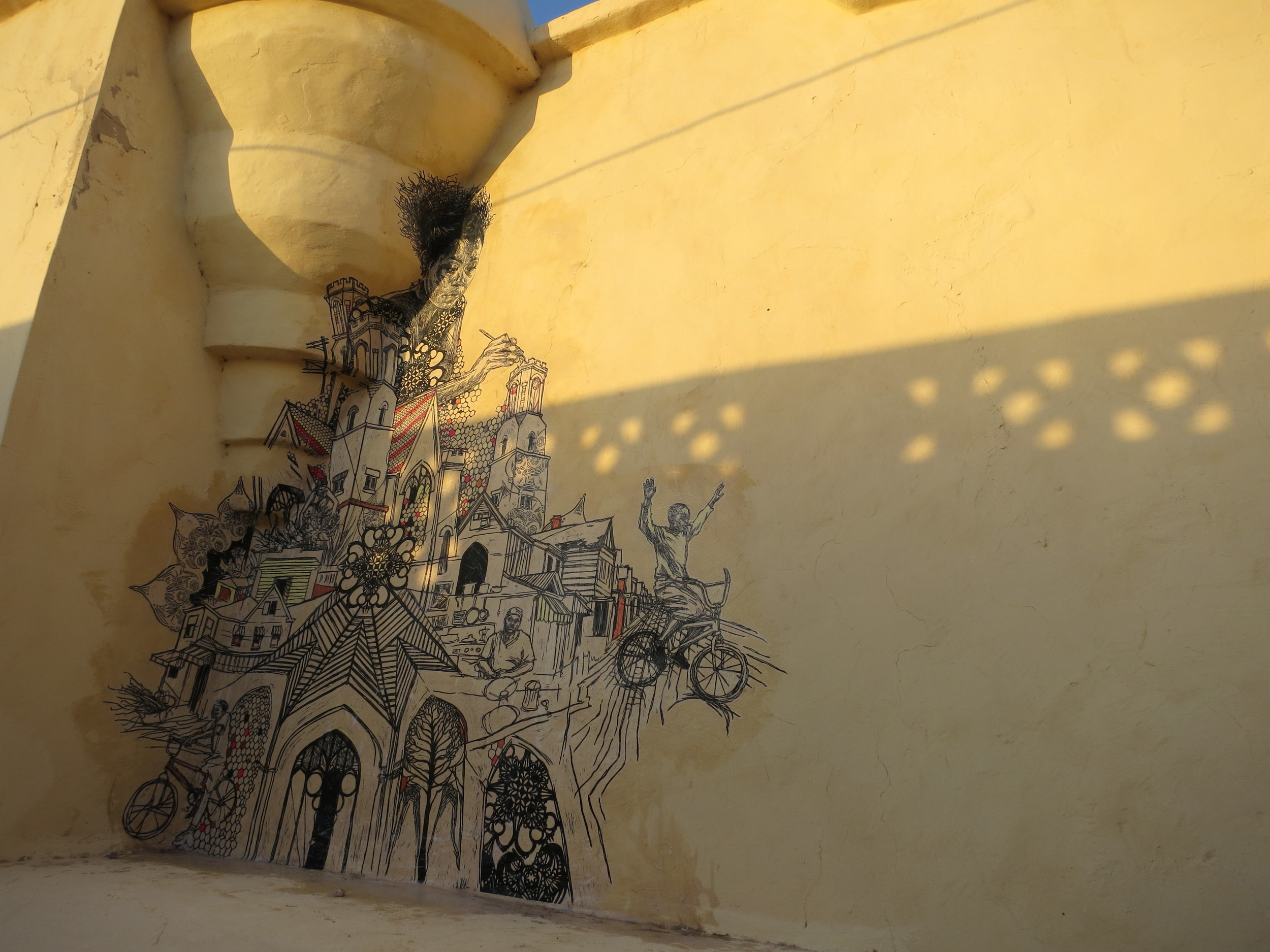 """One of the installations Swoon contributed to the Djerbahood Project (Galerie Itinerrance's """"open-air museum"""" street art project in Tunisia), the 2014 piece is inspired by the Braddock Tiles community arts initiative in Braddock, Pennsylvania. ( Photo : Swoon Studio)"""