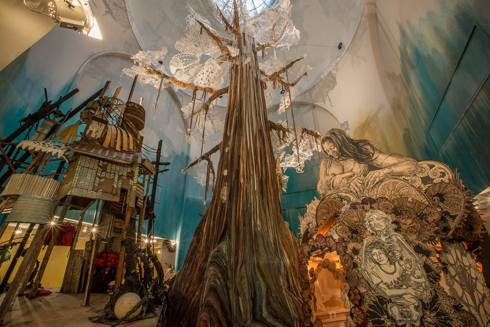 Submerged Motherlands , Swoon's 2014 solo exhibition at the Brooklyn Museum, was centered about a 65-foot tree made of dyed ribbon and paper cutouts. ( Photo : Tod Seelie)