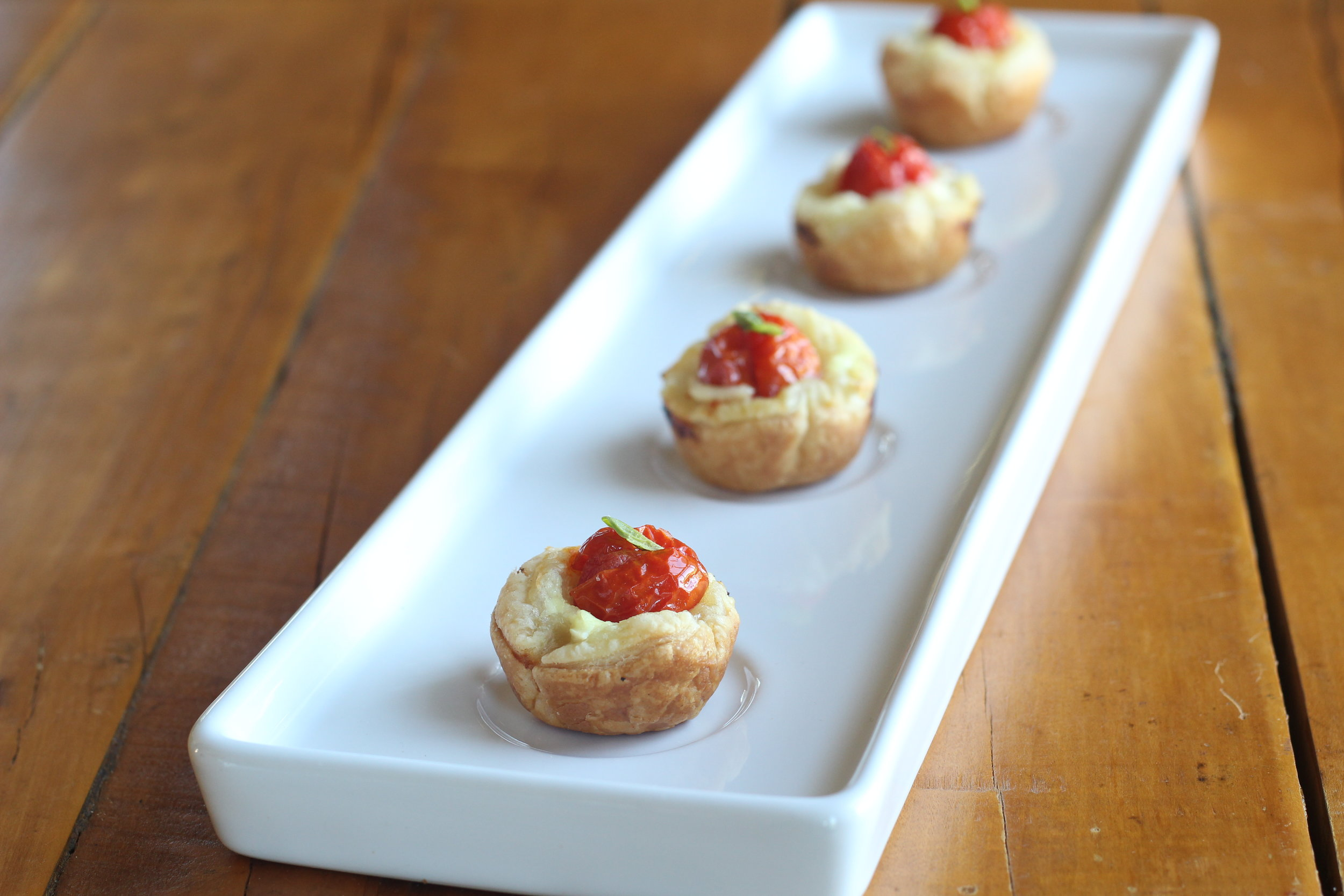 Cherry tomato tartlets plated