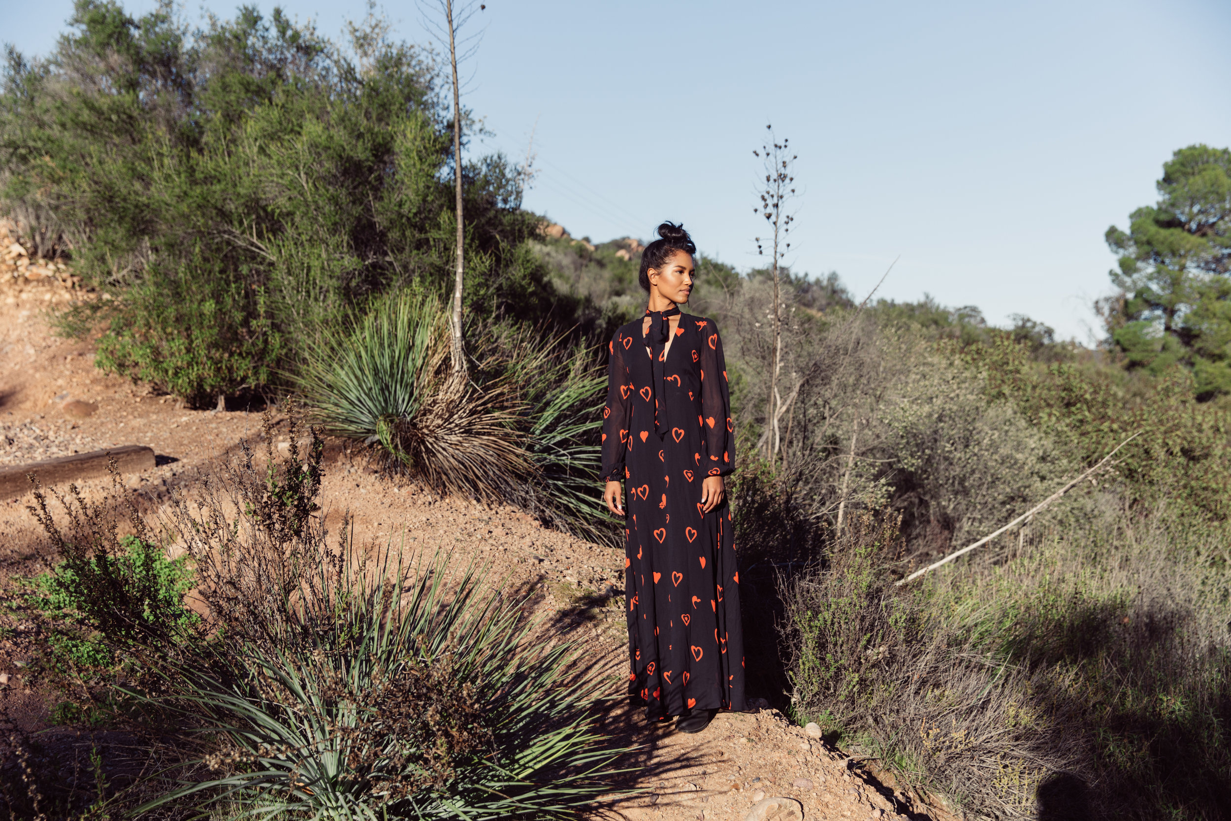 Nikki Joiner  wears the  Stella Long Midi  in love heart print in Topanga Canyon for our SS19 campaign.