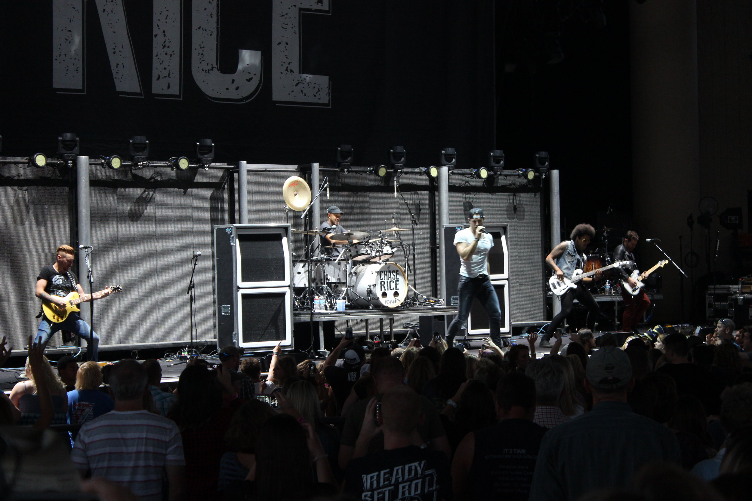 Chase Rice and a stage full of Harpers.JPG