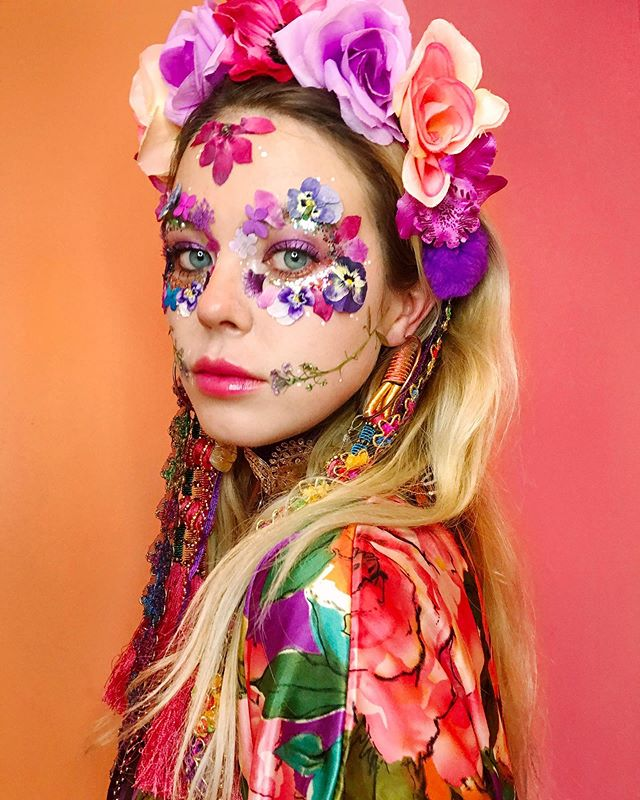 FLOWER POWER 🌷🌸💐🌺🌹 ⠀⠀ A peek at one of our favourite new makeover designs, featuring our bio glitter and real flowers we have pressed from the garden🍃  Team with one of our headdresses for the perfect Mexican Day of the Dead skull this Halloween 🌸💀🌺