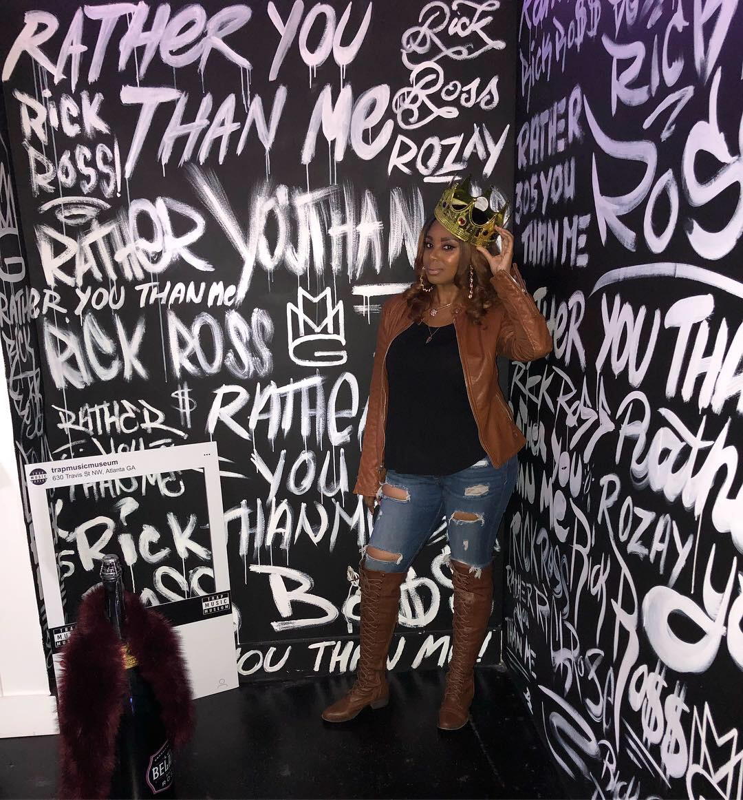 Jennifer J at the Rick Ross exhibit at the Trap Music Museum.