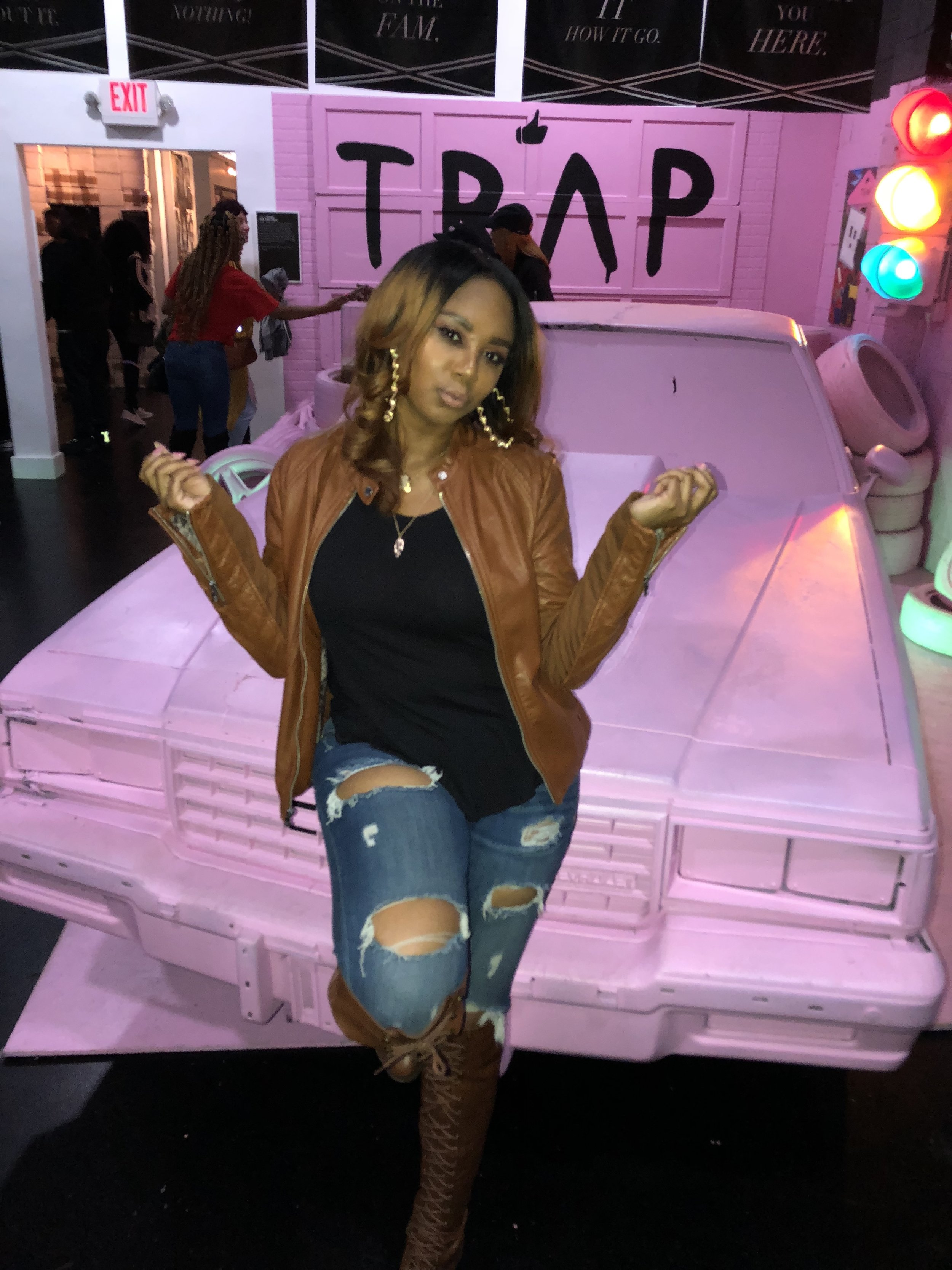 Jennifer J at the 2 Chainz exhibit at the Trap Music Museum.