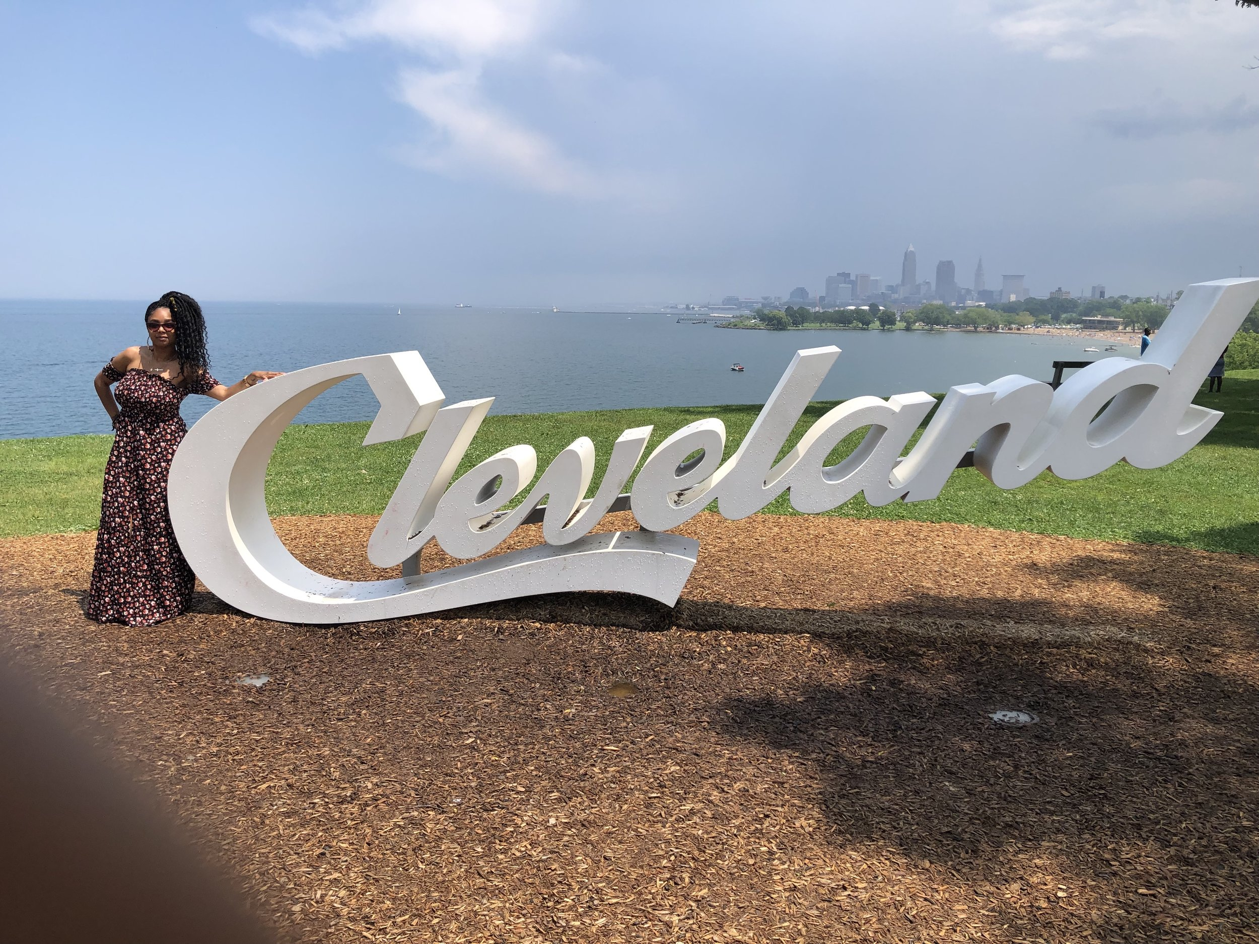 Jennifer J. at one of the four Cleveland landmarks throughout the city. She has pictures with three out of four.