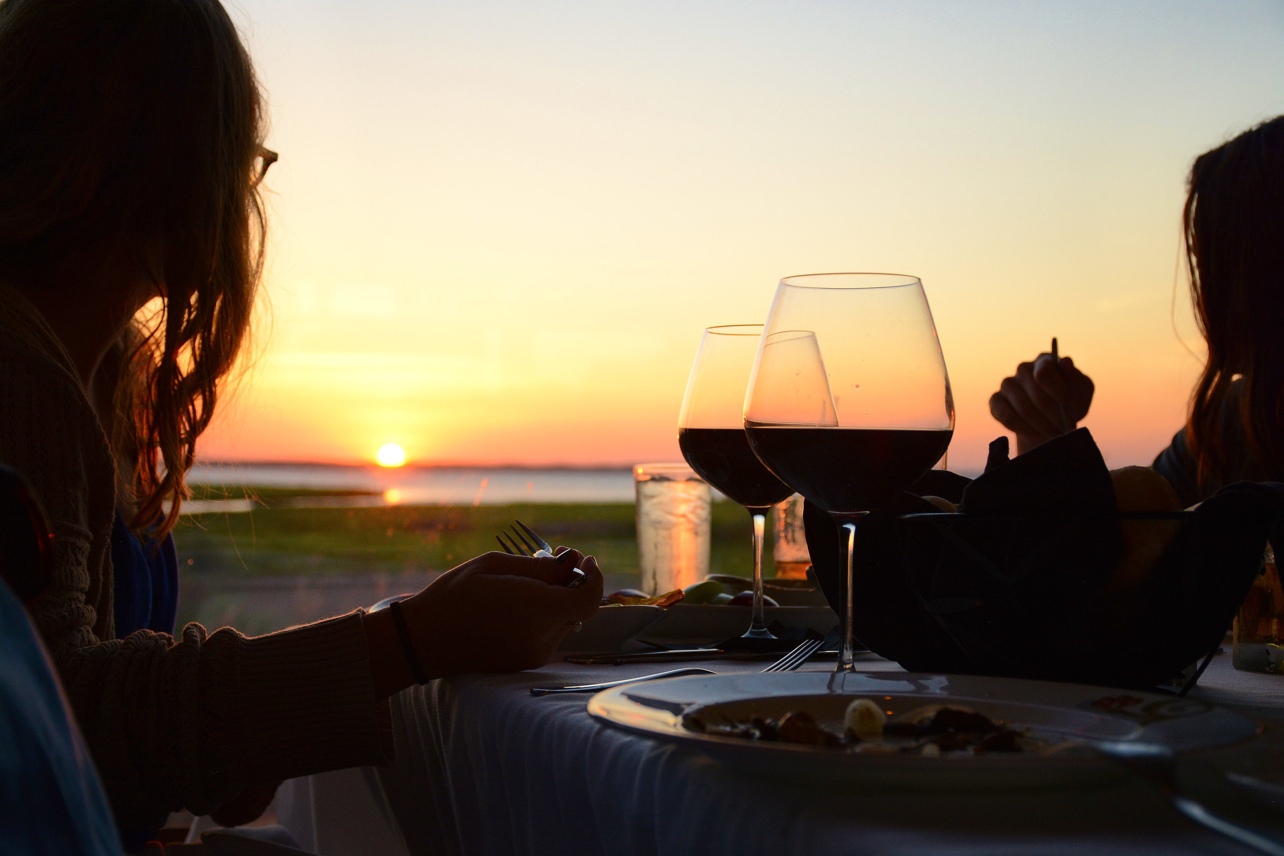 Enjoy a panoramic sunset view from any table.