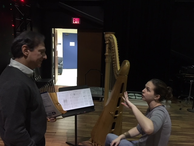 Ken getting feedback on writing for the harp from harpist Casey Perley