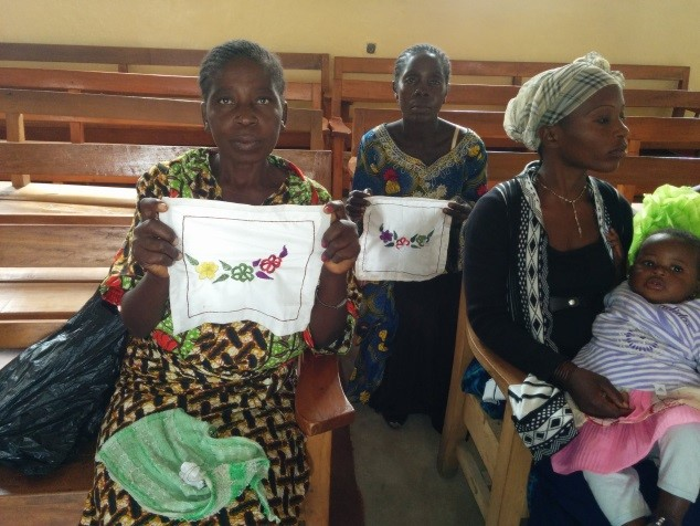 North Katanga women sharing the items they sewed with the supplies we provided.