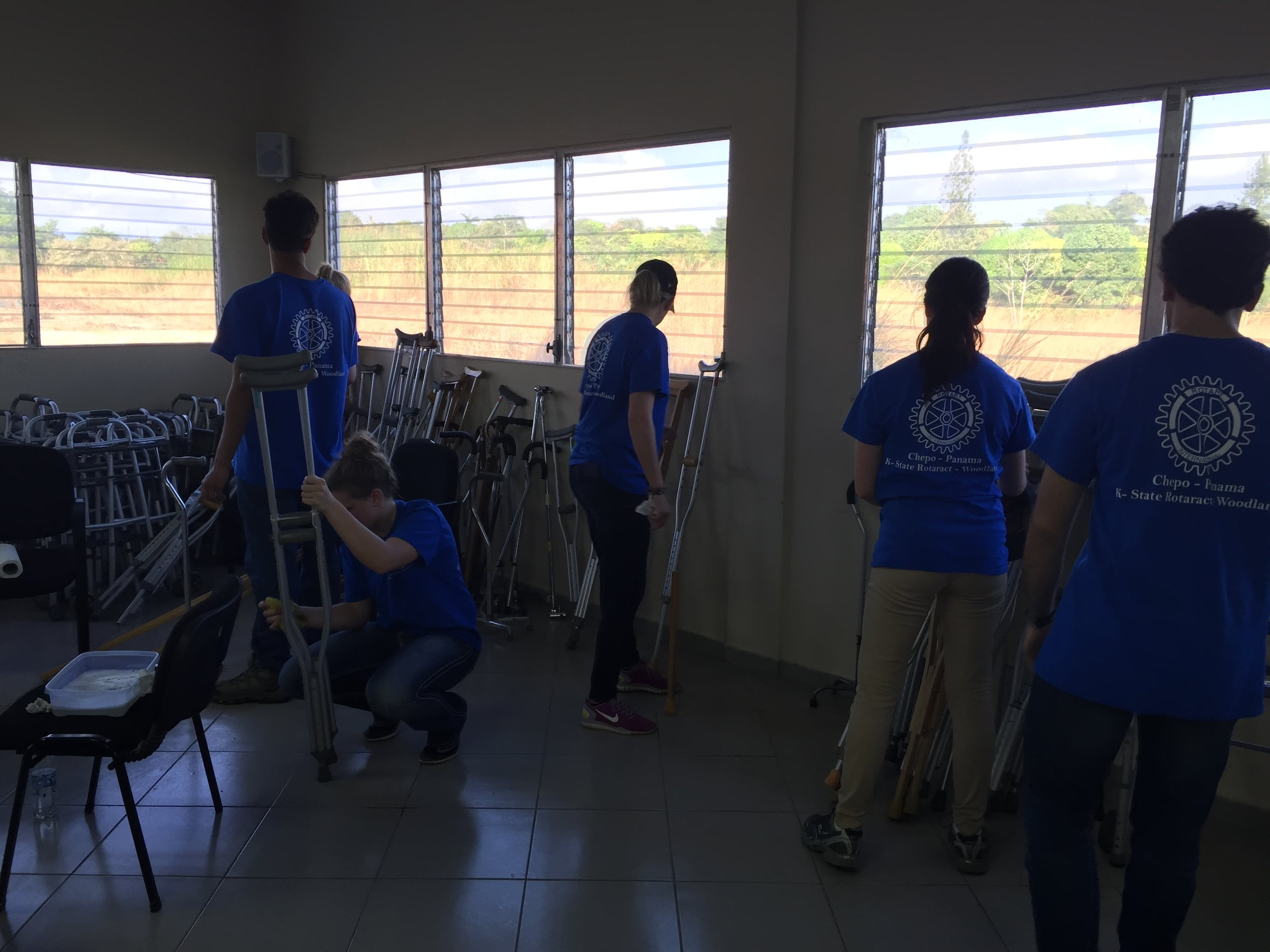 Gathering and washing crutches, walkers and canes to deliver the next day.