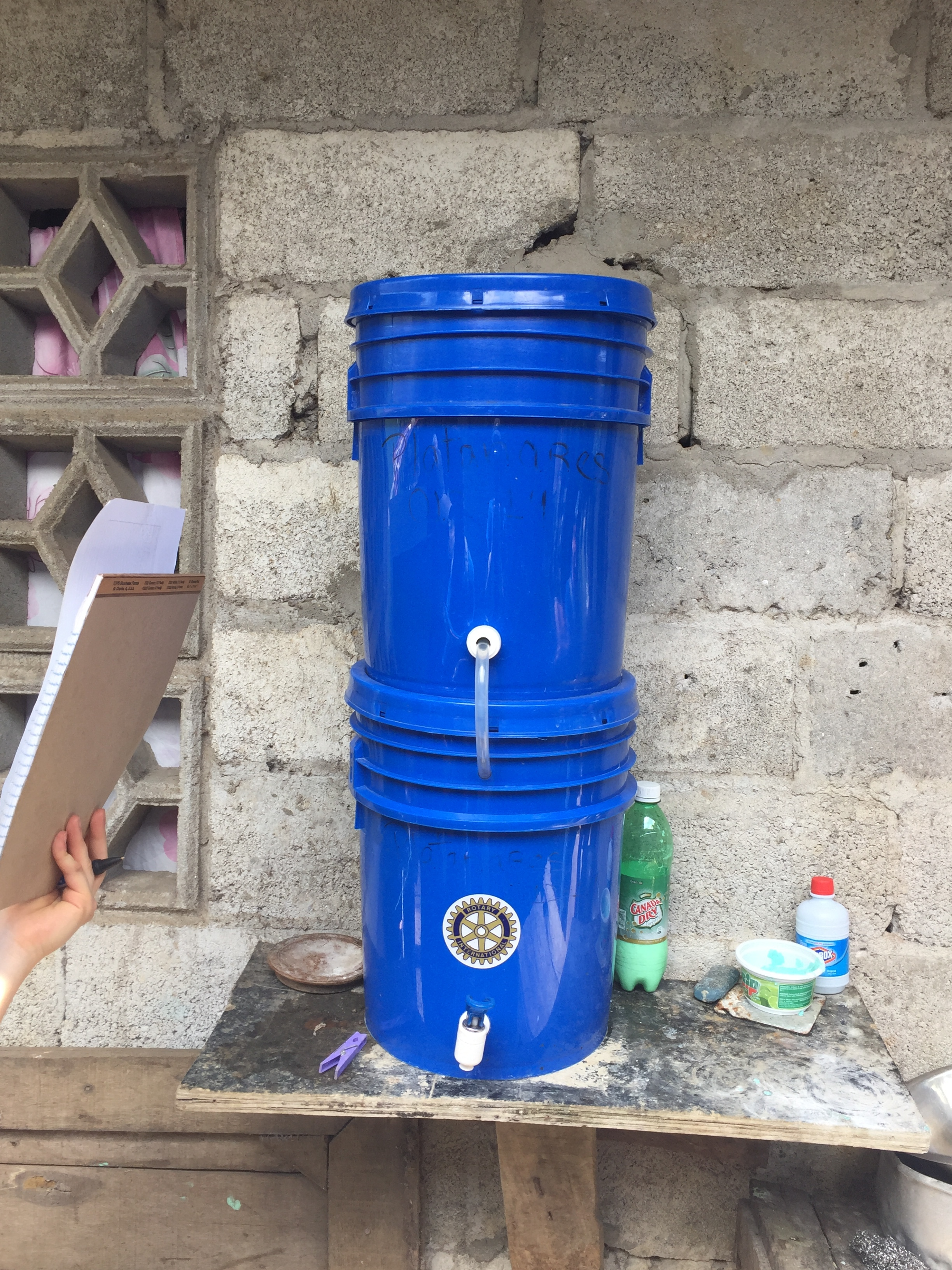 One example of a house visit to check and make sure the family is still using the filter and fix any problems that may have arose. This home scored high on the bucket cleanliness inspection! We were very happy to hear they were using the water filter and often. However, our civil engineering students recommended adding more support to the shelf as it was supported by one crooked nail at the moment ;)