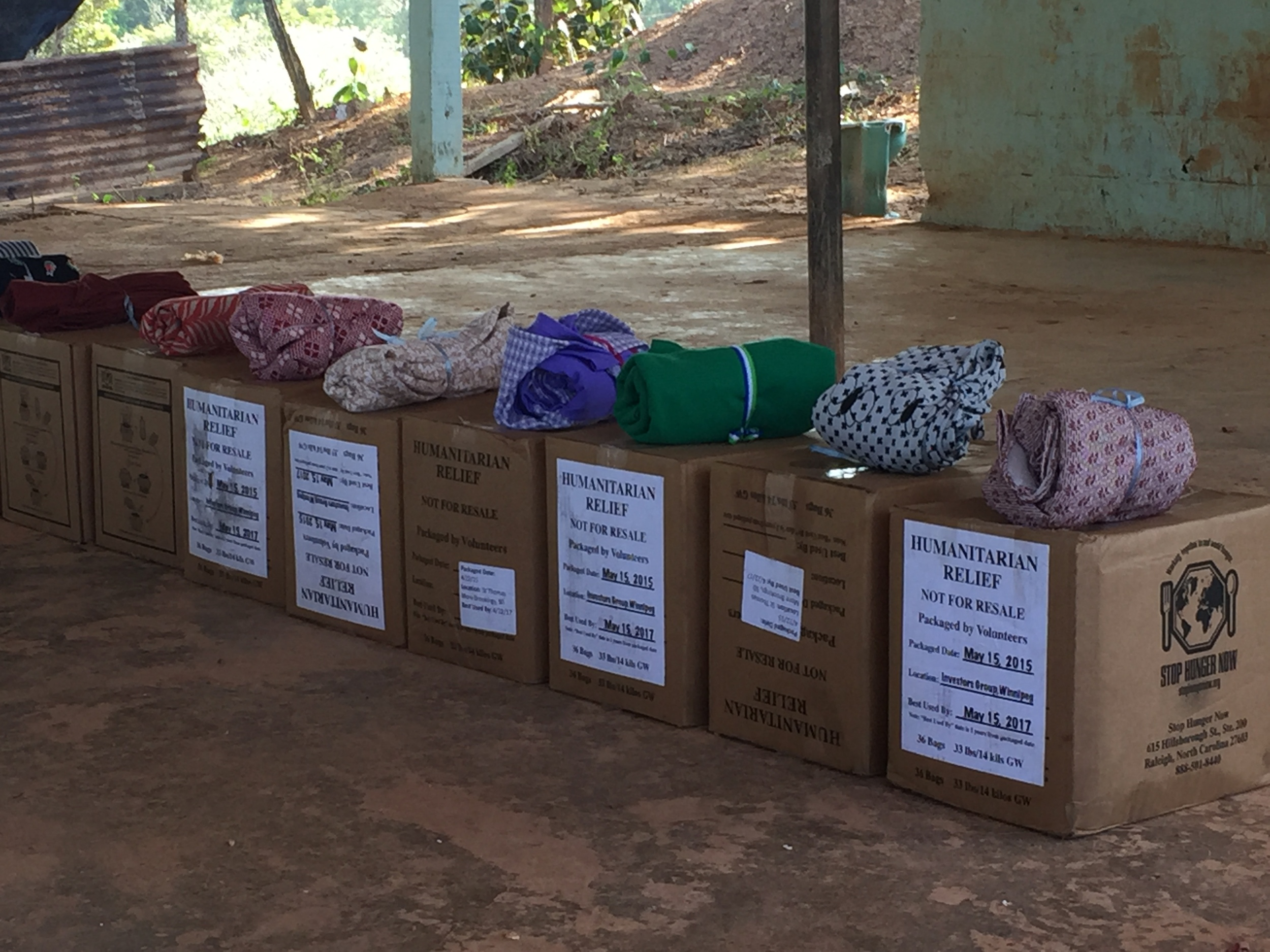 Delivering food and water filters to families in Unicito community. The cloth bundles on top are covers for the water filter so that the spigot has less chance of contamination.