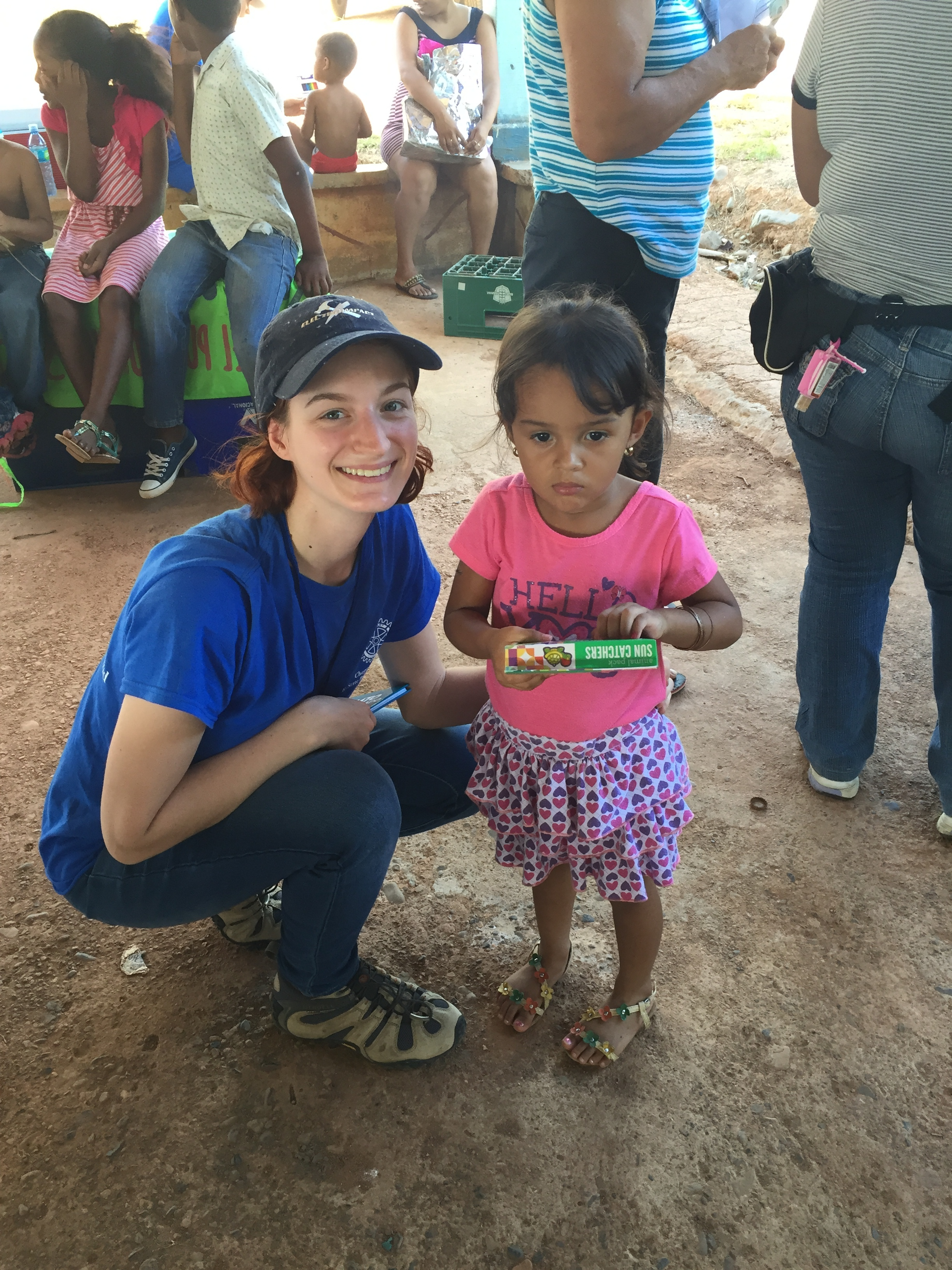 Team members gave out donations to children including books, puzzles, coloring pencils, and more!