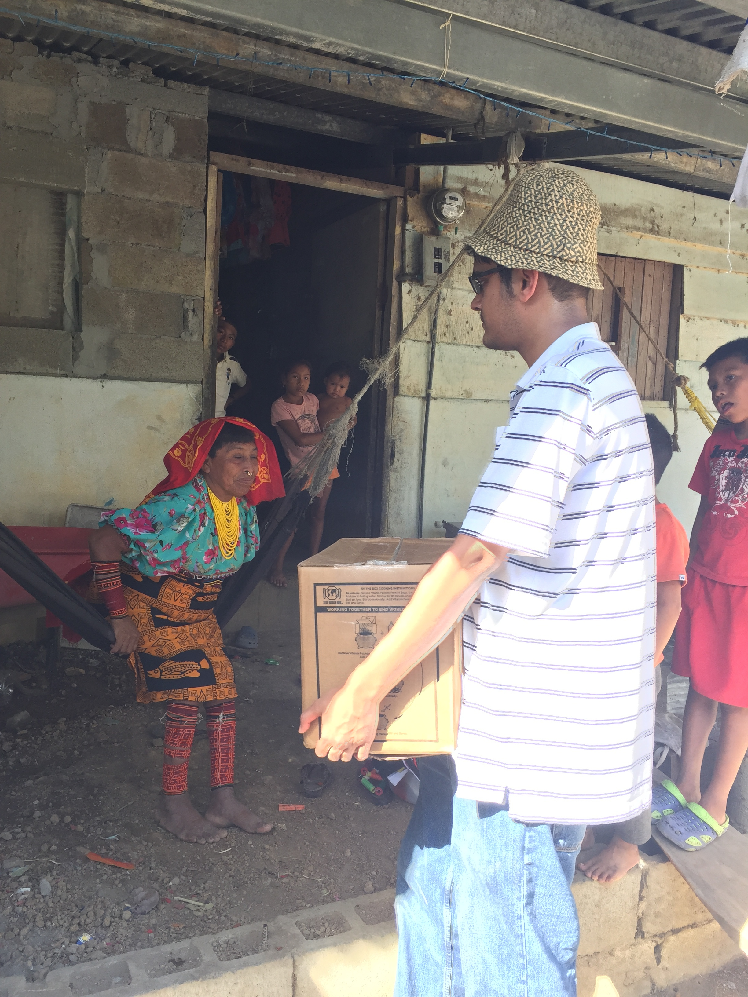 Chenna delivering food to a home