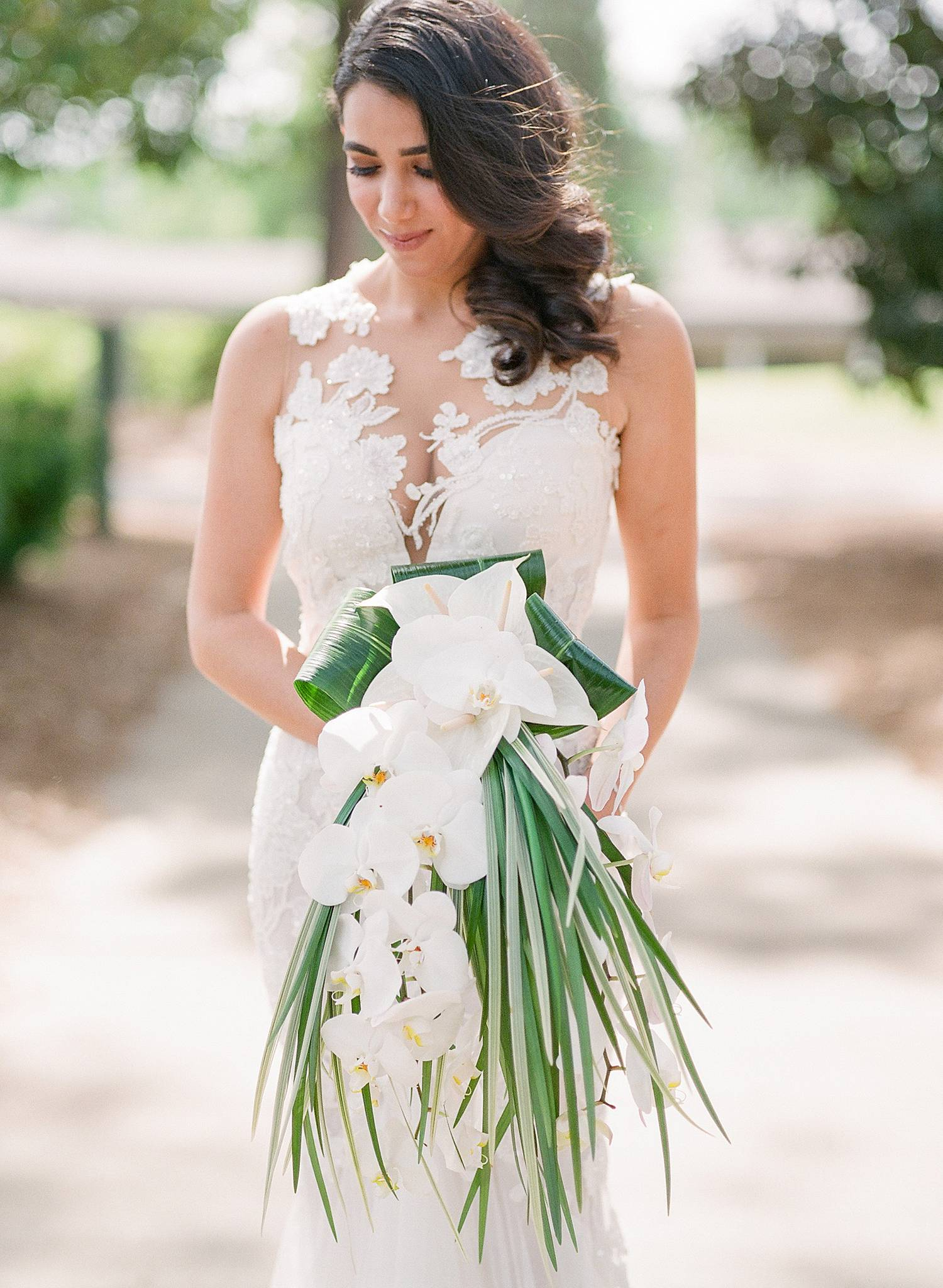 Featured Floral: orchids, palm leaves, variegated aspidistria, anthrium - Lynnette + Dylan, West Lake Country Club, Ashley Seawell Photography