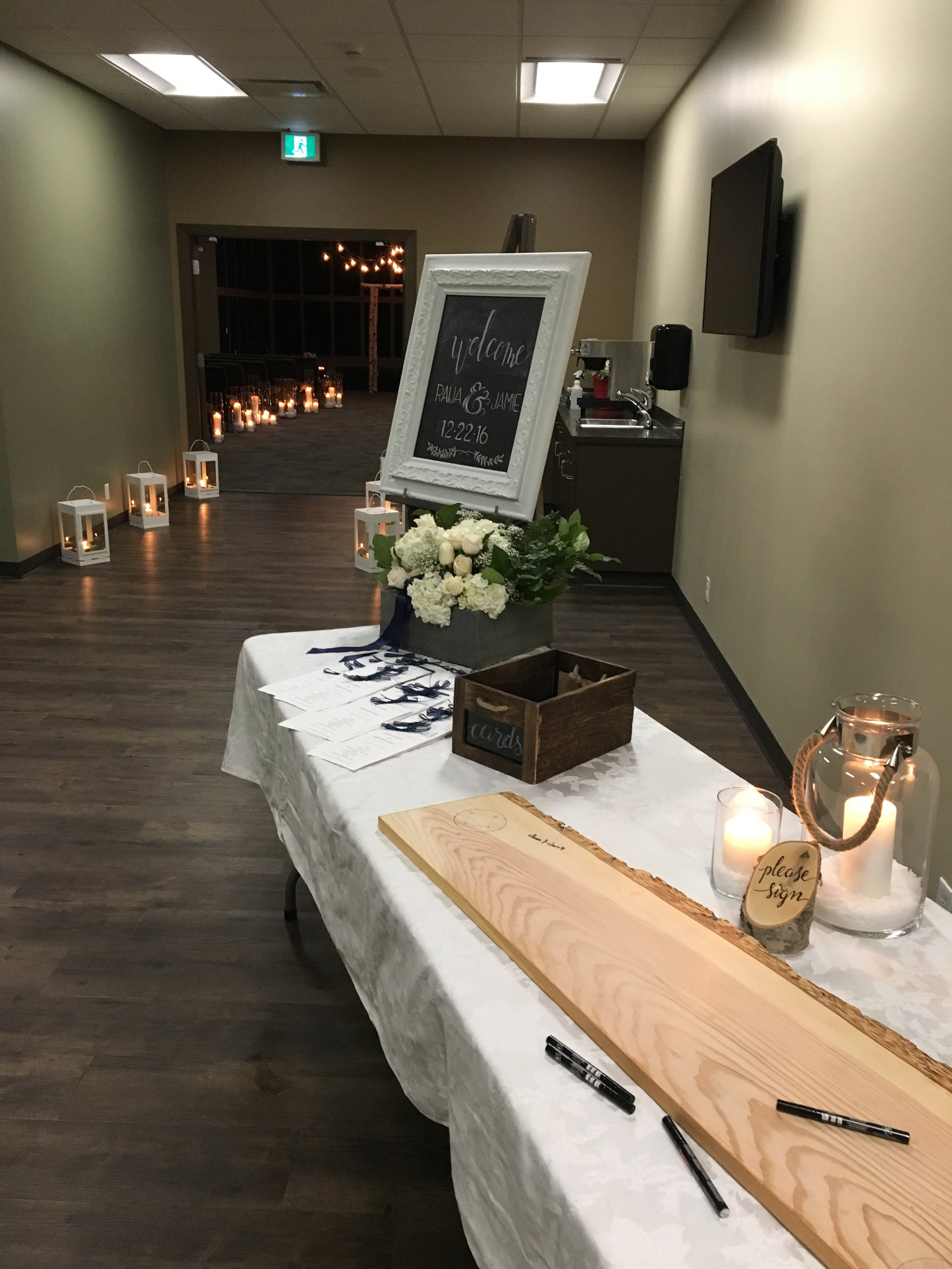 The guest book table, made by the brides father, was flipped over and legs screwed on for a sweet statement piece at the reception.  What a great keepsake!