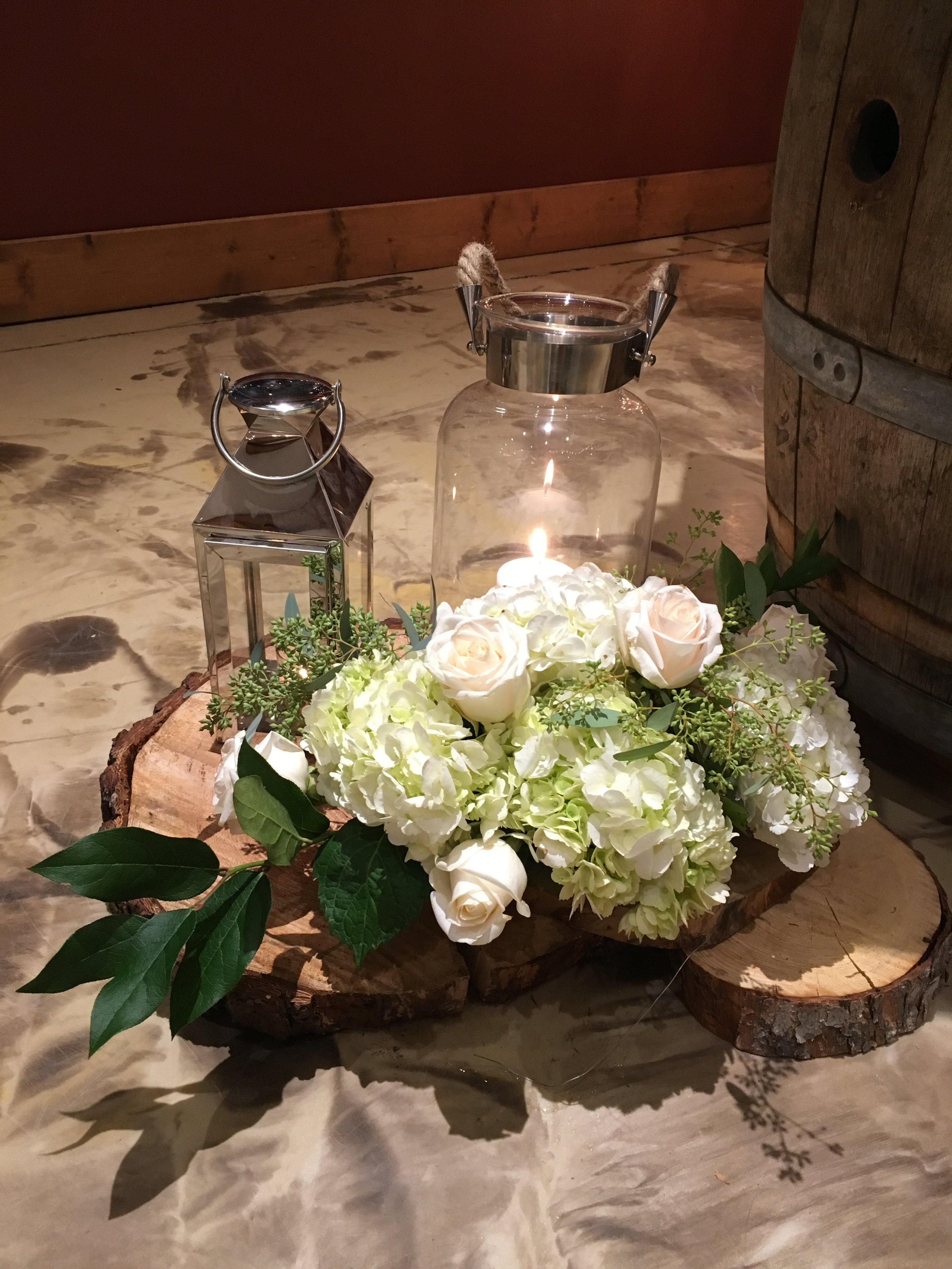 The day was filled with so many fun details made by the Father of the Bride.  From the living edge guest book table to birch wine bottle holders, birchwood arch, and birch tea light holders for each guest to take home.