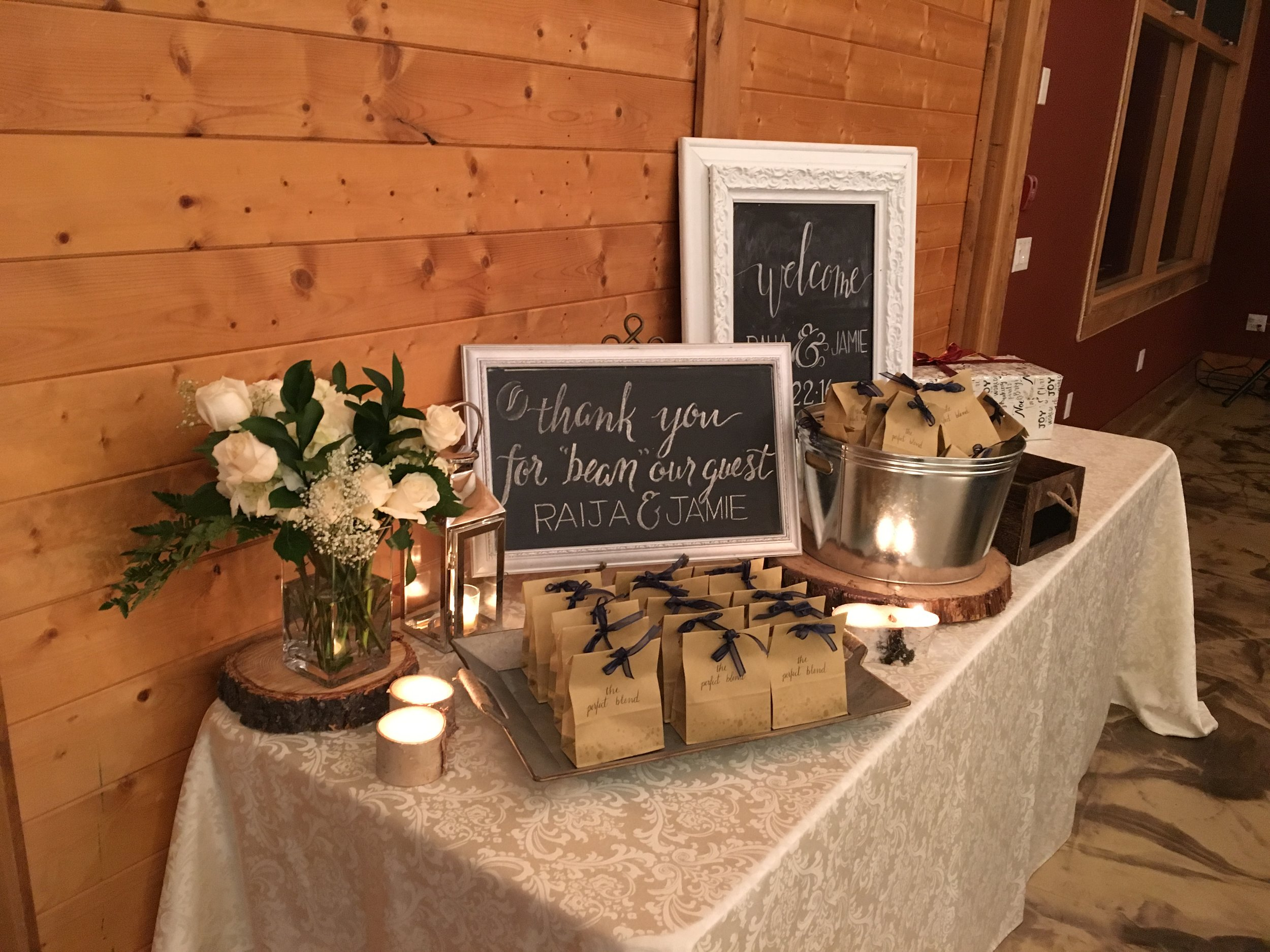 "The bride incorporated her love of coffee into the day with a bag of fresh coffee beans for each guest to take home, ""Thank you for 'bean' our guest""."