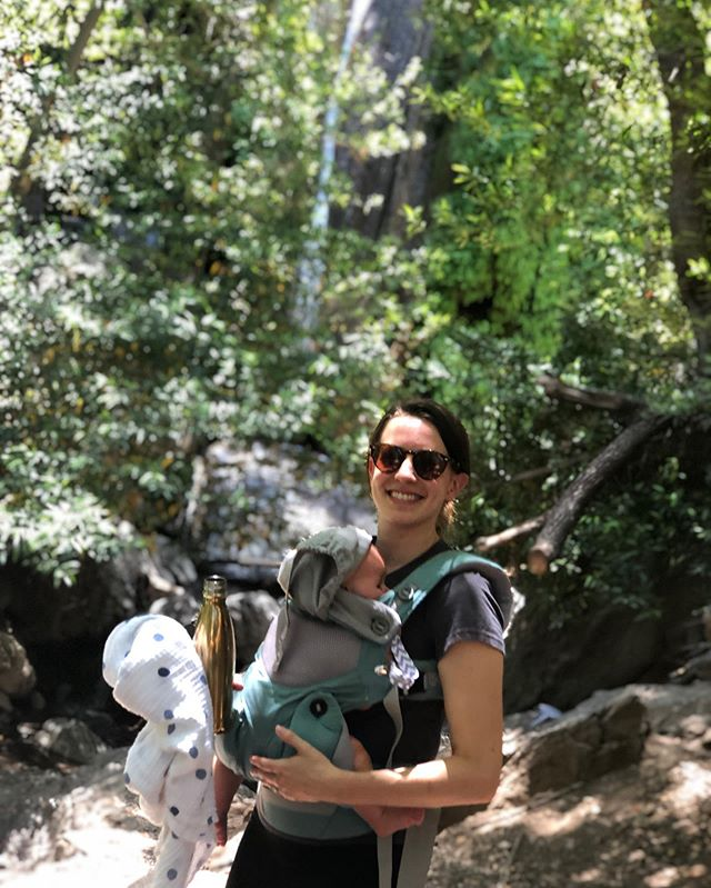 Photo of an ill advised short hike to a waterfall that was supposed to be shaded but all the trees had burned so it was very hot and the baby didn't like it but we got that waterfall pic honey