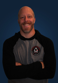 Jay Bell  - Jay is the founder and head coach of Gracie Farmington Valley. He has trained for more than 16 years, and received the second stripe on his black belt from Grand Master Marcio Stambowski. He has trained with some of the biggest names in Jiu-Jitsu and Mixed Martial Arts, such as Royce Gracie, Rob Kahn, Rodrigo Gracie, and many others. Jay is a Marine Corps veteran, a scout master, husband, and father of two. His spirit animal is the octopus.