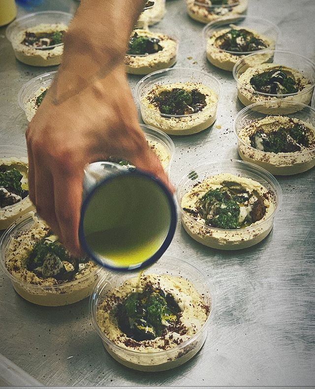 Little bowls of freshly made hummus - these ones topped with grilled aubergine, spicy herby zhoug and a drizzle of olive oil 😋 🌶 🍆 🌿 - - #hummus #hummuslover #catering #mezze