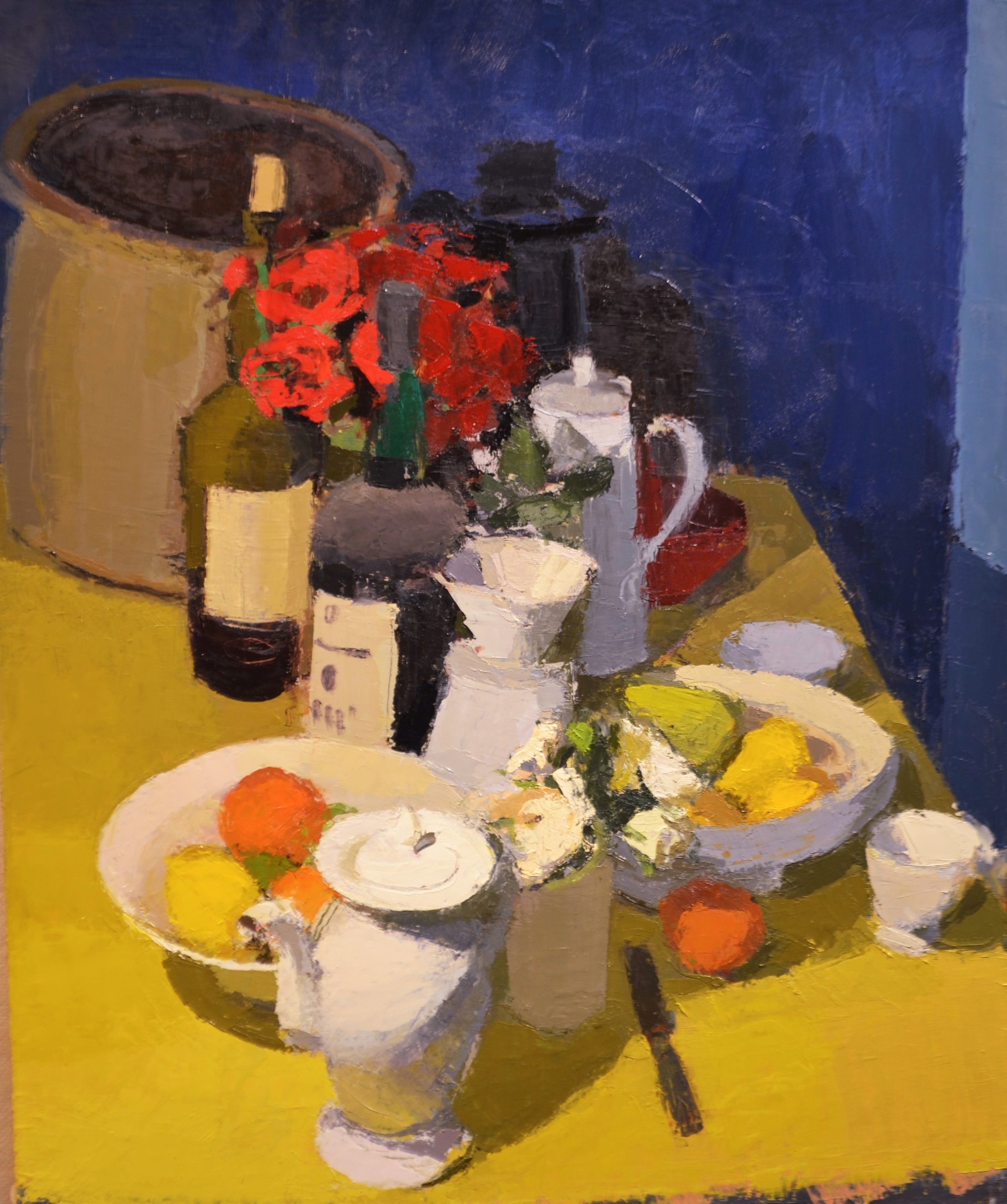 Yellow Table with bottles, fruit and flowers.JPG