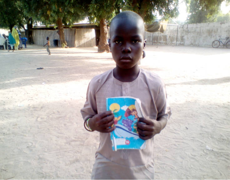 Ibrahim Street Child Nigeria read write.jpg