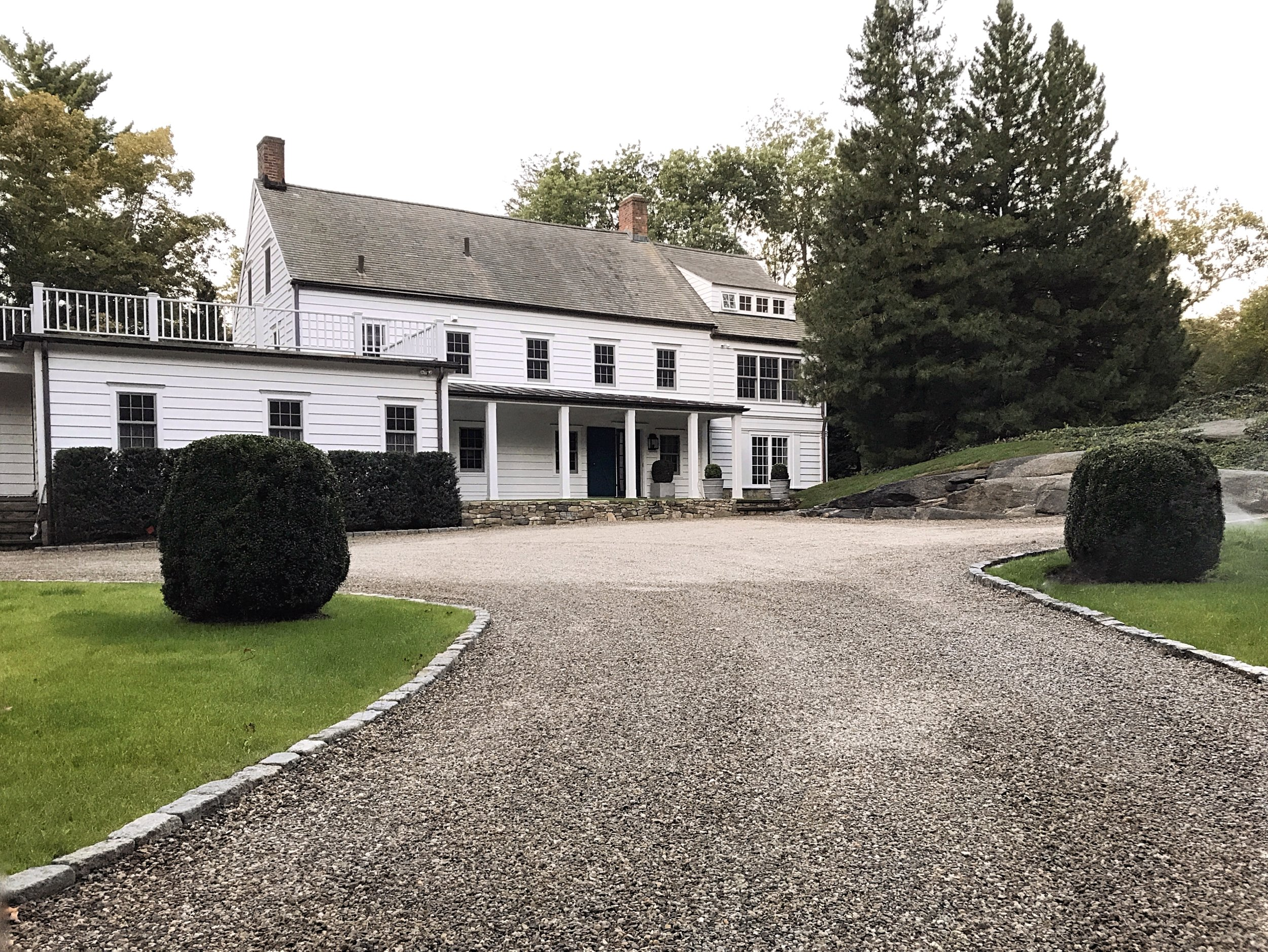 Renovated 18th Century farmhouse with a reconfigured driveway approach and front entry to home