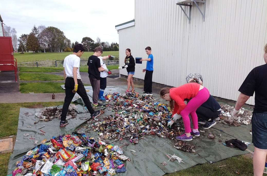 Eltham students sort the litter collected from under the school deck to identify recyclables.