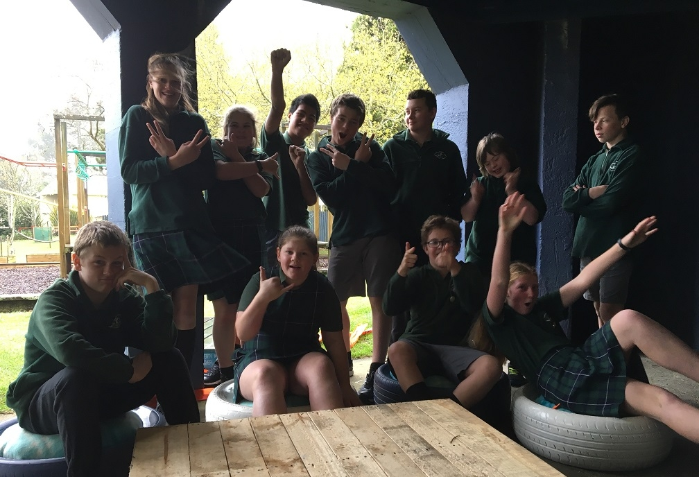 St Partrick's students celebrate the successful completion of their upcycling project.