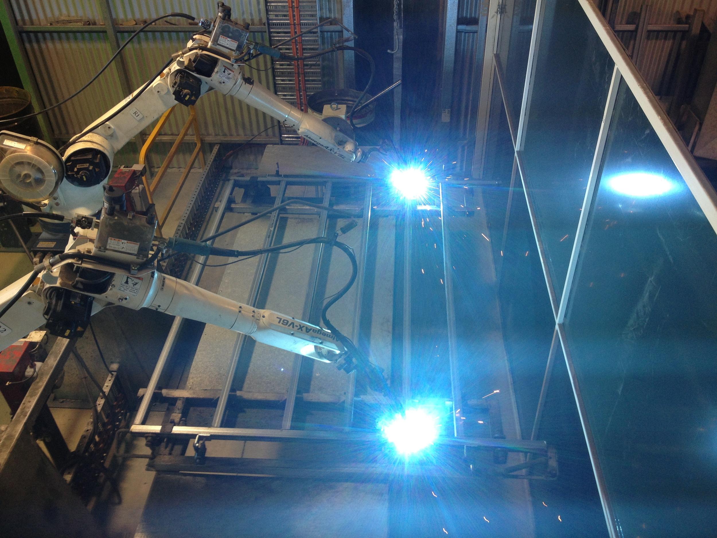 Robotic welders - welding a panel