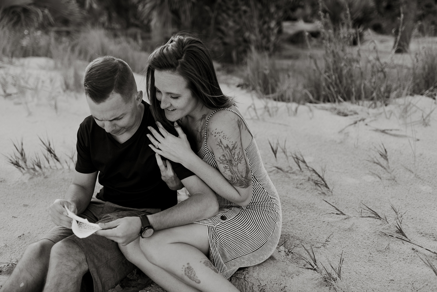 Love letters during a Hunting Island State Park couples photo session in South Carolina