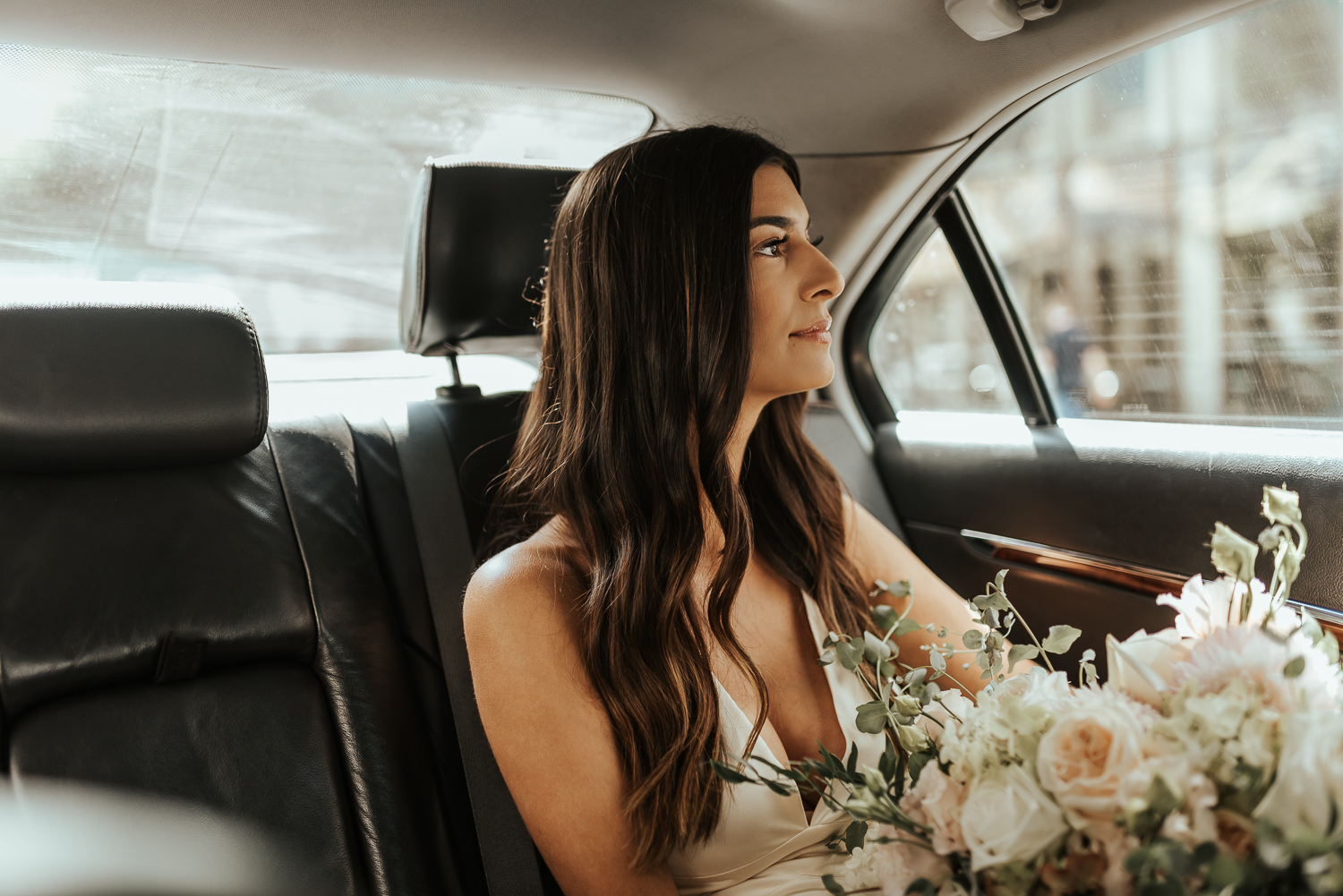 On the way to the ceremony - bride in an Uber - Philly elopement