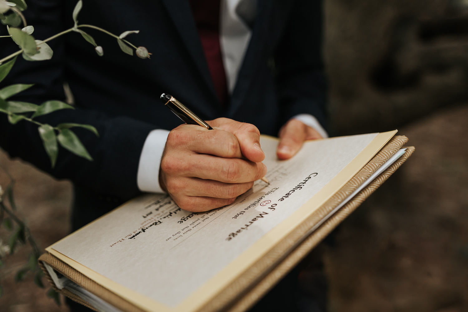 Sign their marriage certificate with a pen that had belonged to Gianna's father.