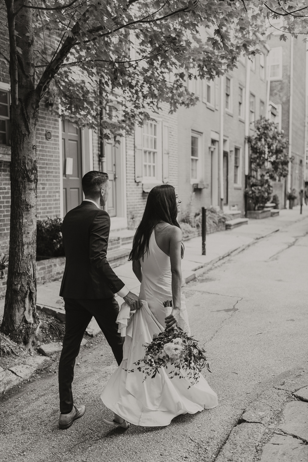 Center City Philly Elopement | bride and groom walking through the city