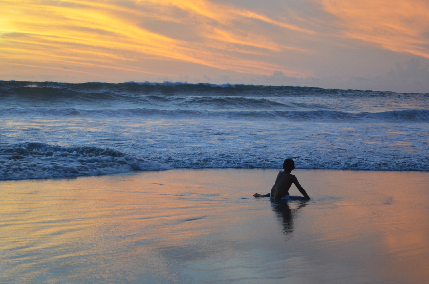 Beautiful sunsets in Seminyak. The beach has dark sand and huge waves excellent for surfing!