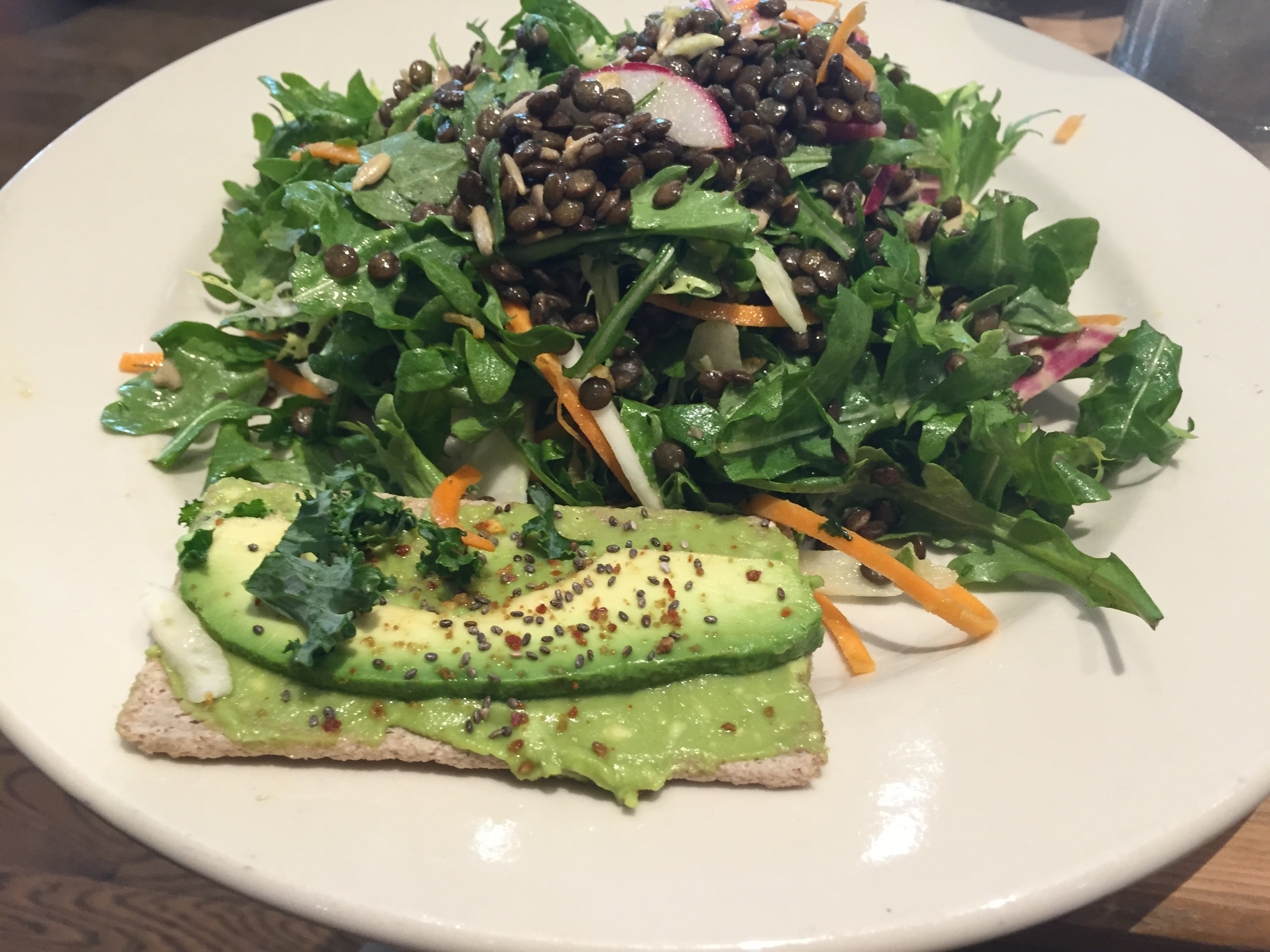 This gluten free avocado toast is the bomb.  It comes with about five pieces on these buckwheat crackers that are actually pretty decent.  I have one of them paired here with the Lentil and Avocado salad.  This is my favorite thing, and I try to get it every time.  I would 100% recommend it.