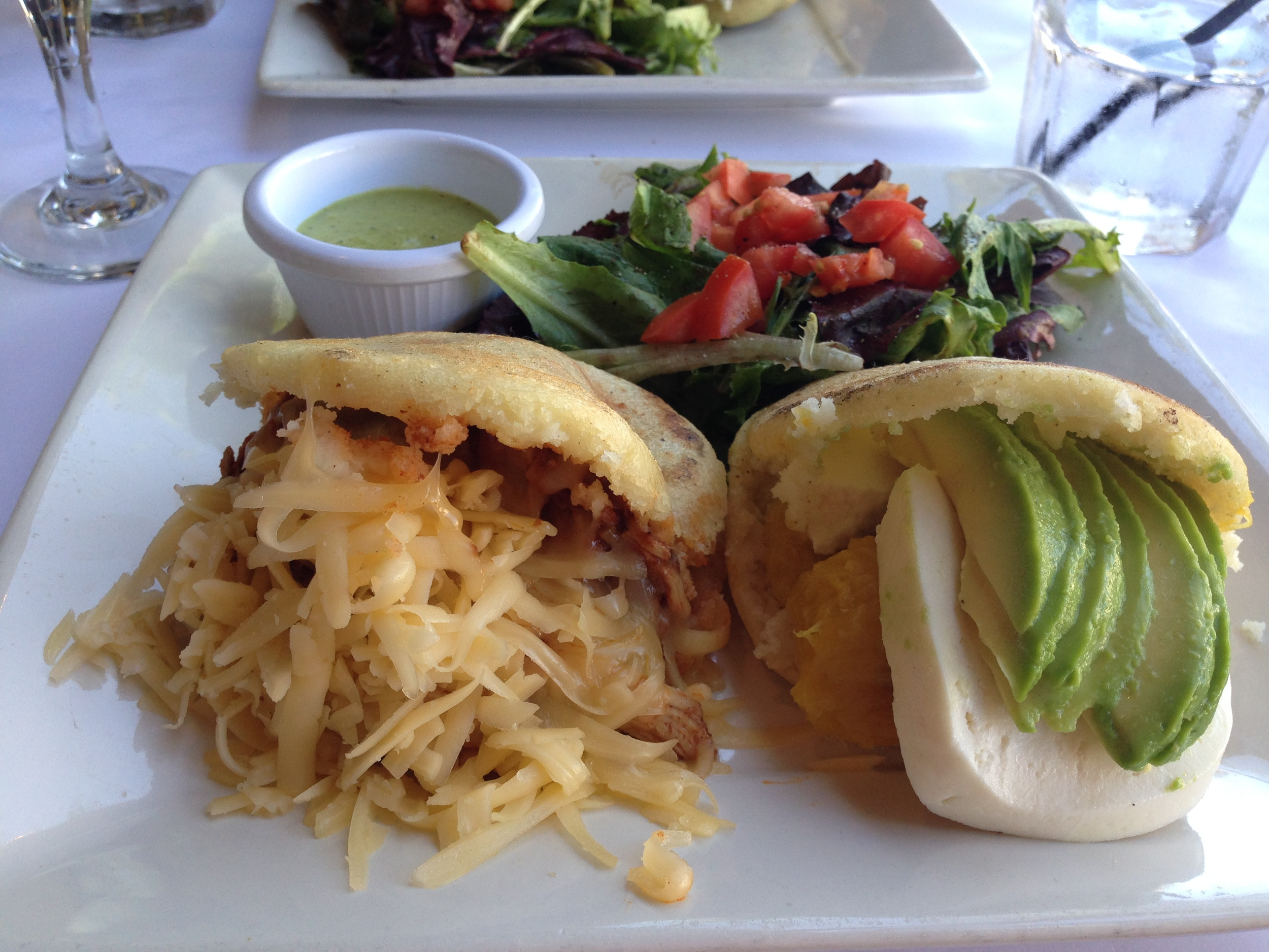 I think the one on the right is the Cami's Arepa ,and the one on the left is the Pelua. They're all good. You really can't go wrong.