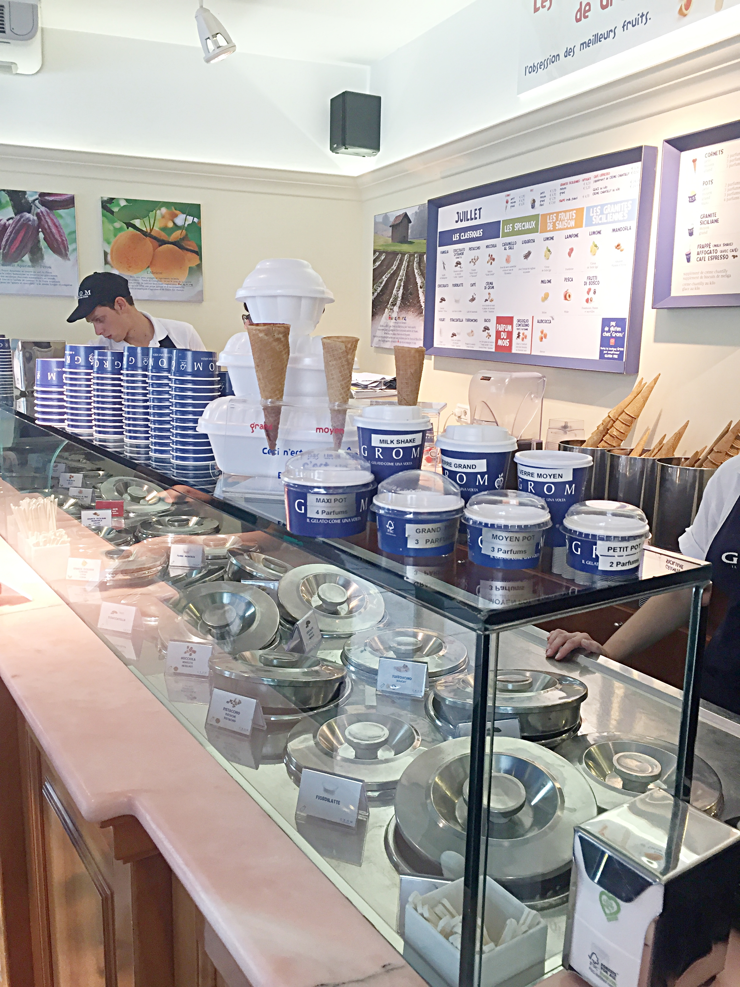 You order first at the counter by picking your size and if you want a cone or a cup. Then you pay and move around to the other side to wait to be called to tell them what you want.